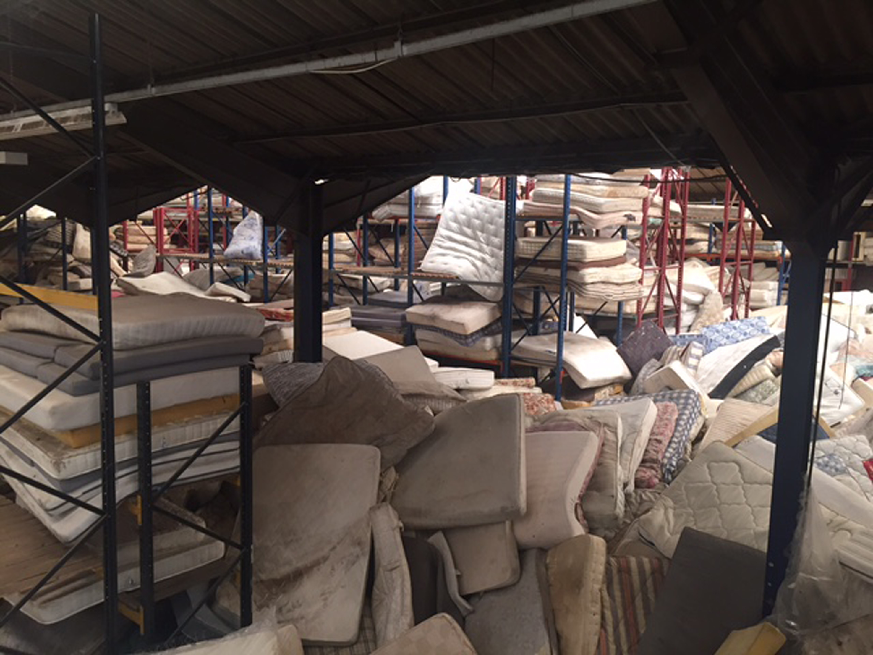 Discarded mattresses at a recycling centre.