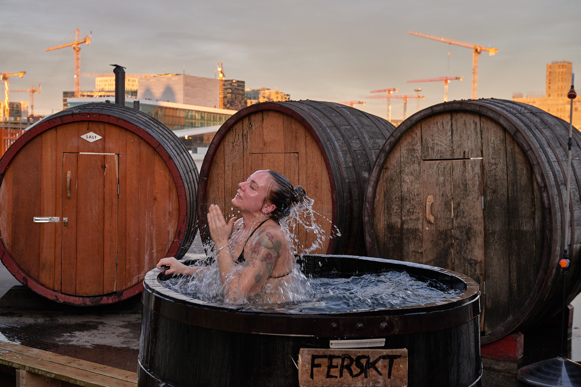 Cooling off in a barrel of cold water outside the sauna at SALT. (Baard Henriksen/PA)