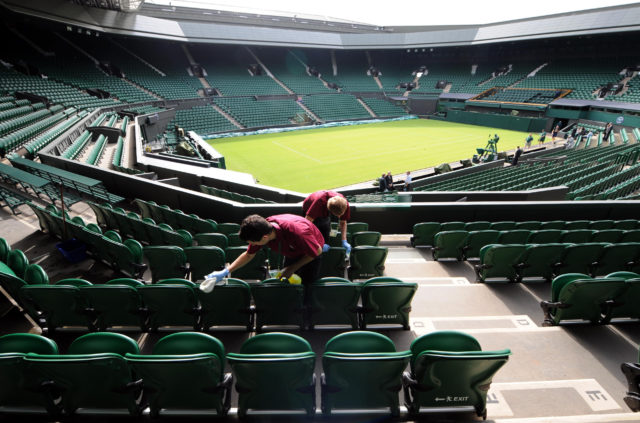 The seats in Centre Court are cleaned ahead of during day one of the 2011 Wimbledon Championships at the All England Lawn Tennis Club, Wimbledon.
