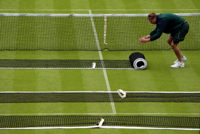 The nets are prepared on Centre Court during a practice day for the 2010 Wimbledon Championships at the All England Lawn Tennis Club, Wimbledon.