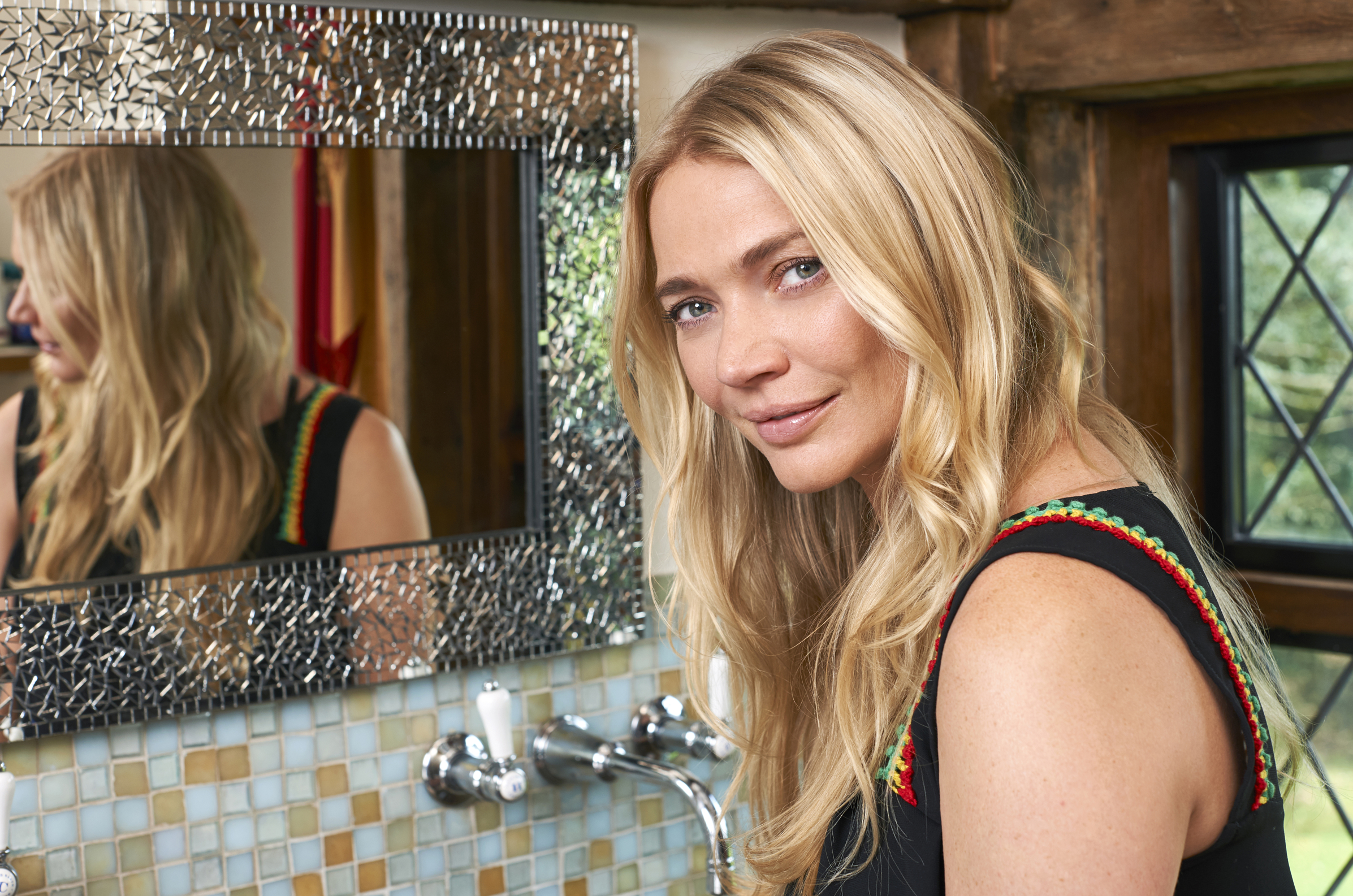 Jodie Kidd smiling in front of a mirror (Denplan/PA)