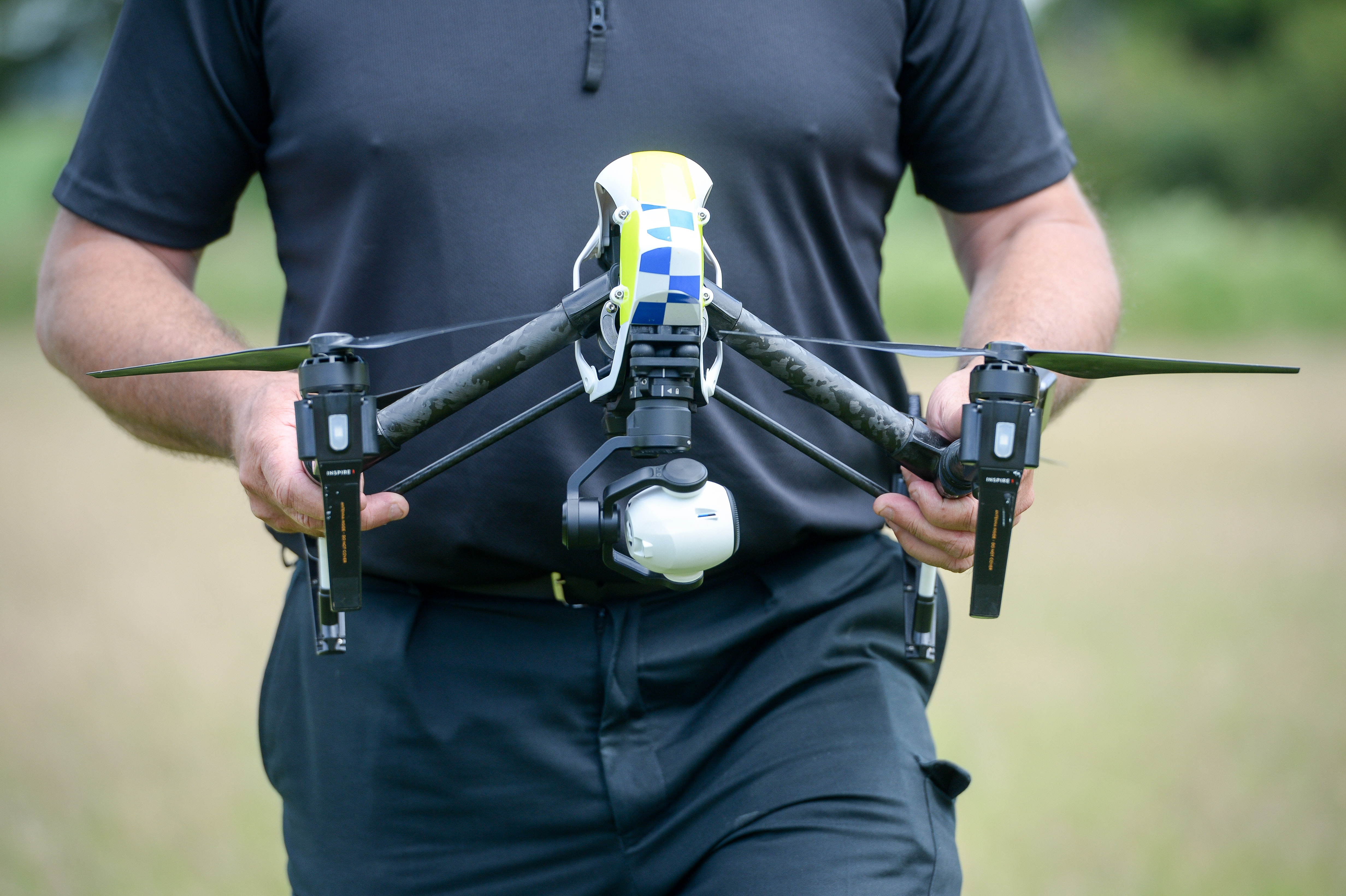 The drone in the hands of an officer