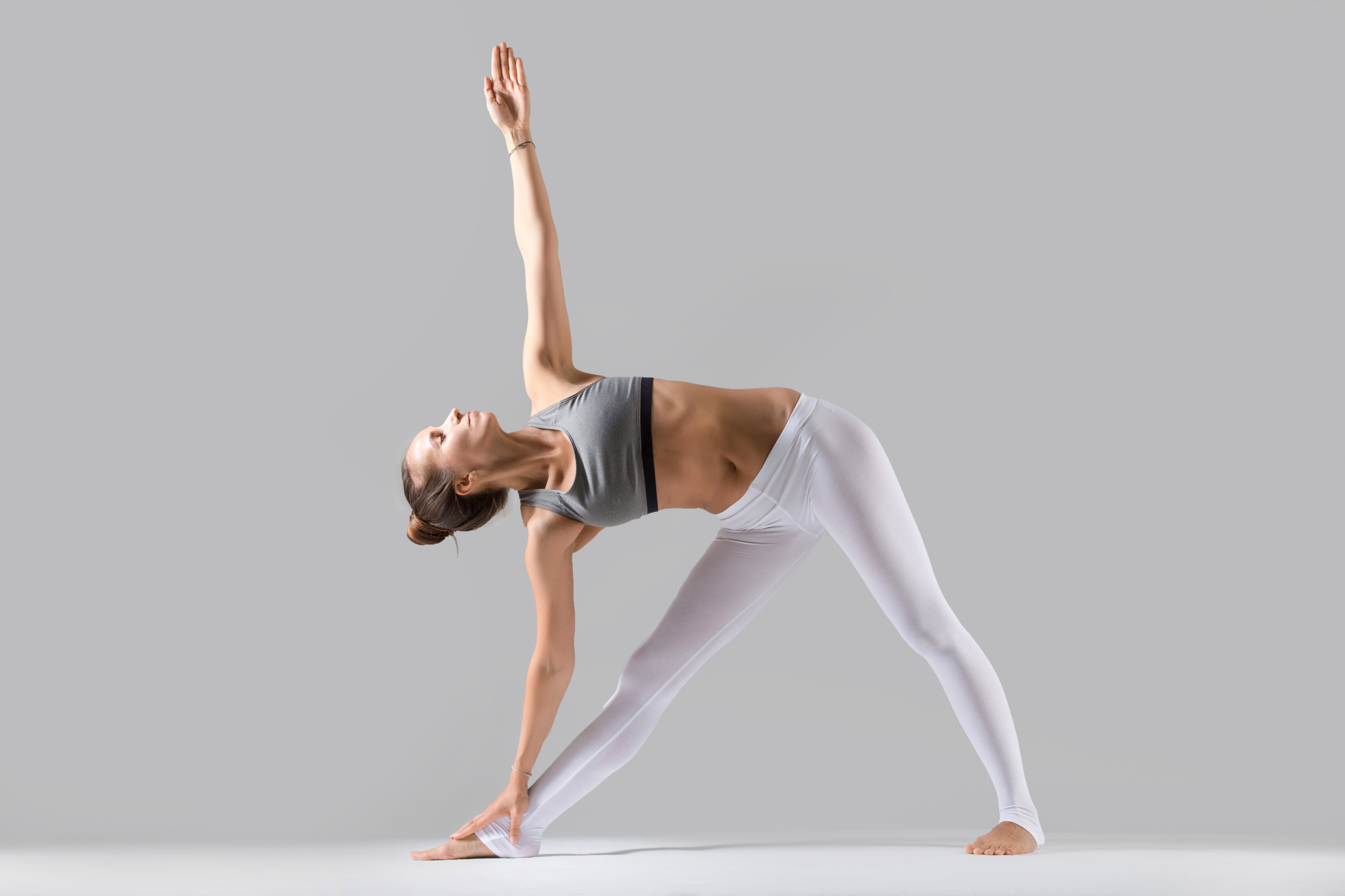 Generic photo of woman doing triangle yoga pose (ThinkStock/PA)