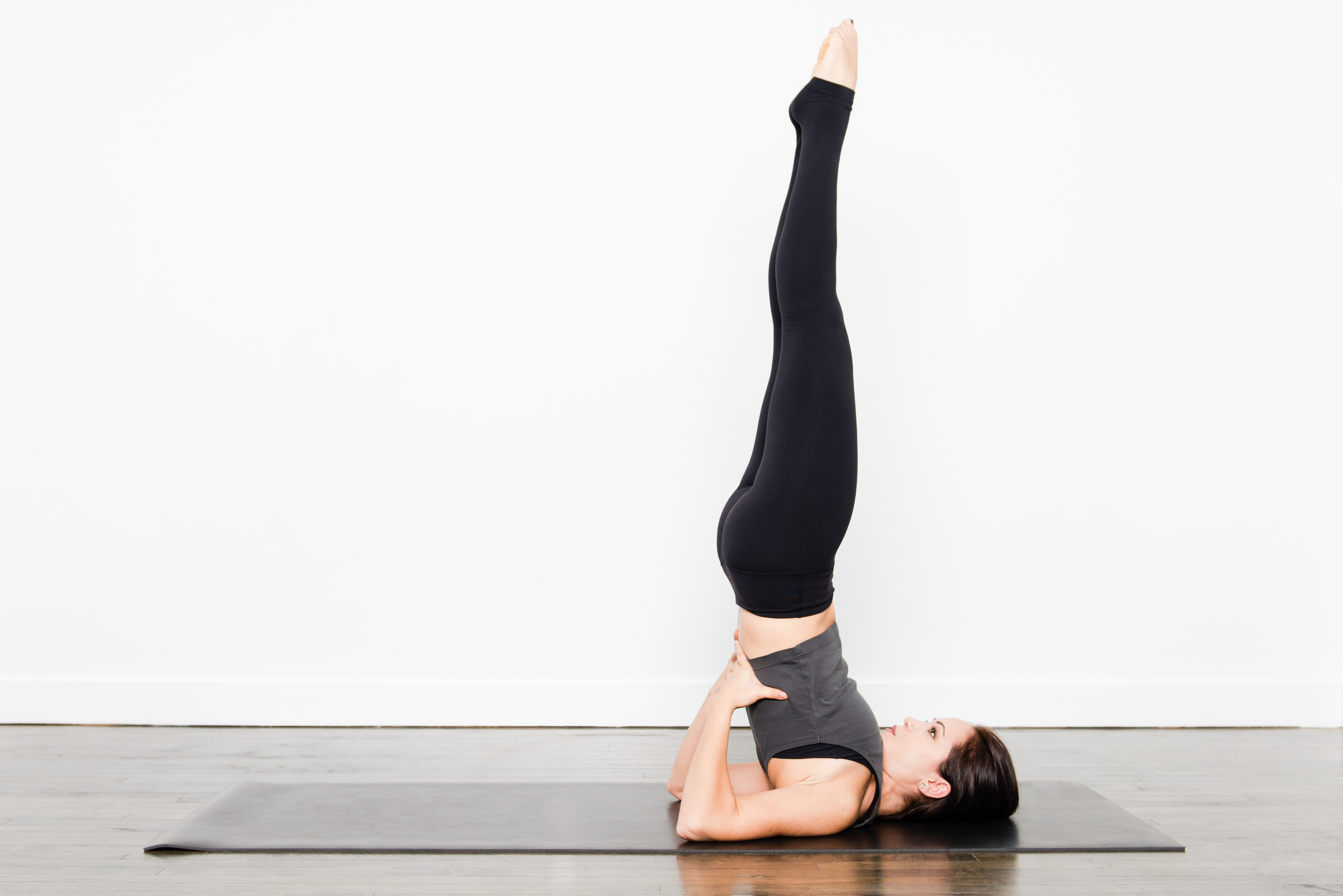 Generic photo of woman doing yoga shoulder stand (ThinkStock/PA)