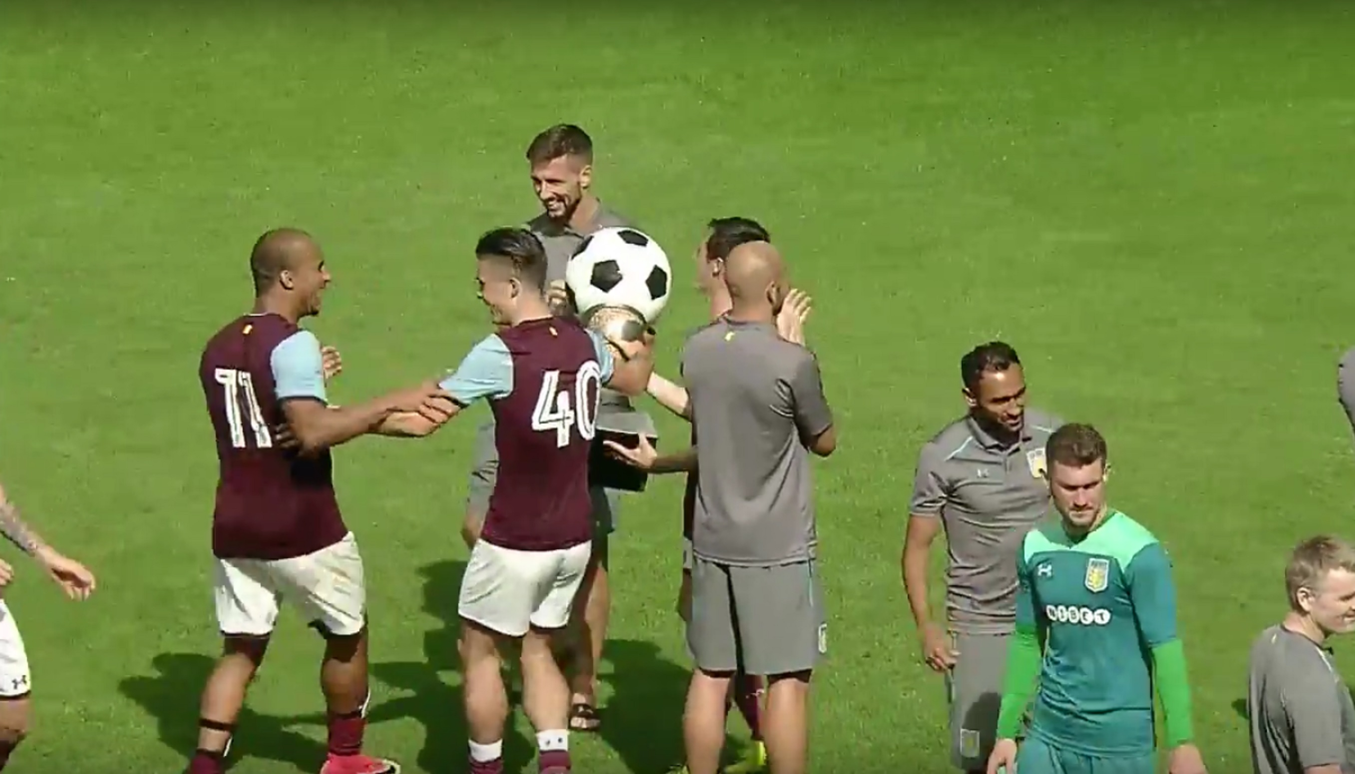 Aston Villa footballers celebrate winning the Cup of Traditions