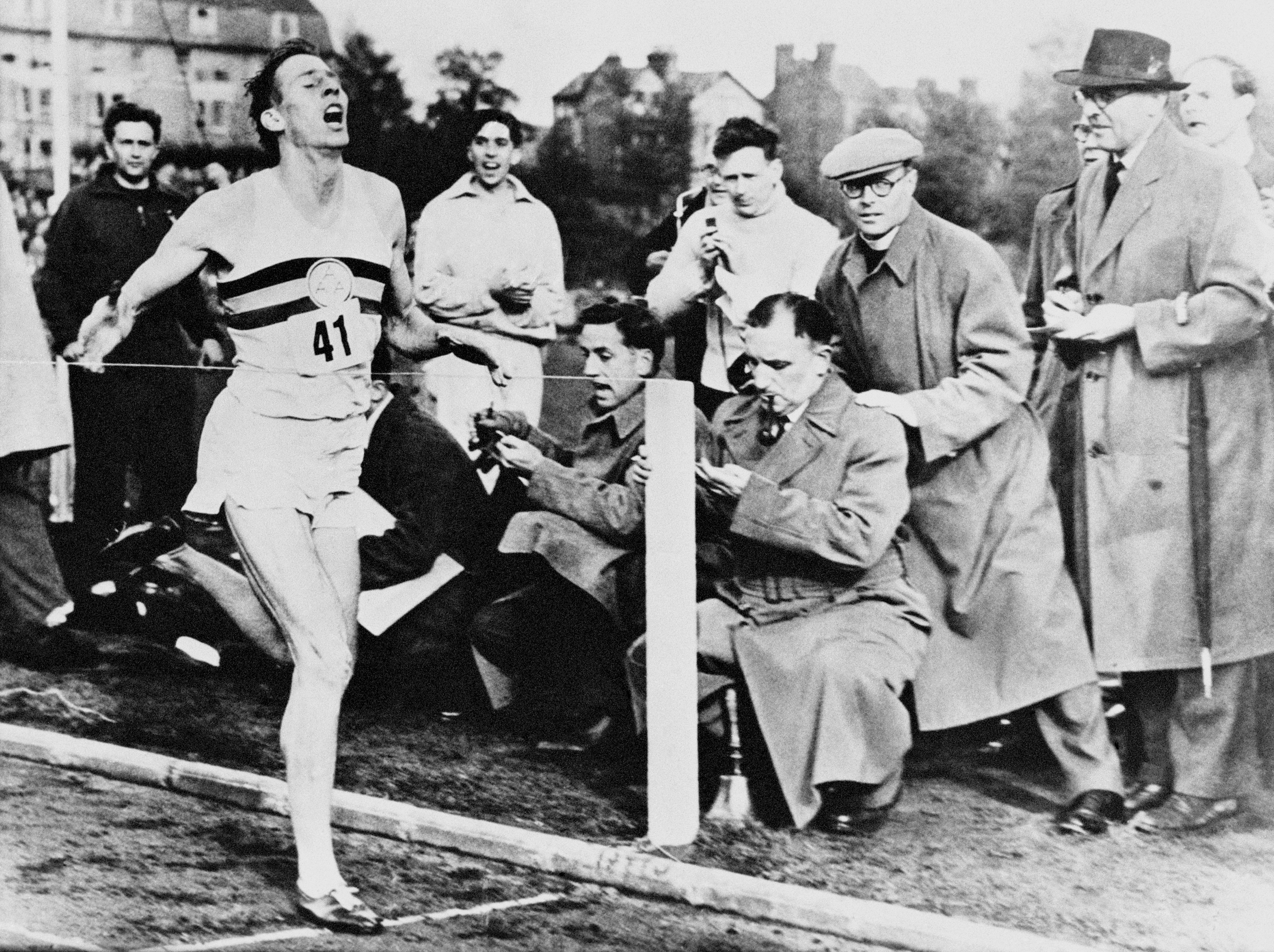 Roger Bannister completes a sub four-minute mile
