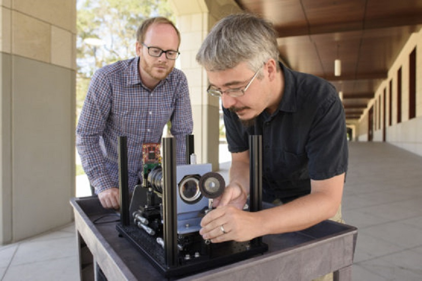 Assistant Professor Gordon Wetzstein, left, and postdoctoral research fellow Donald Dansereau with a prototype of the monocentric camera