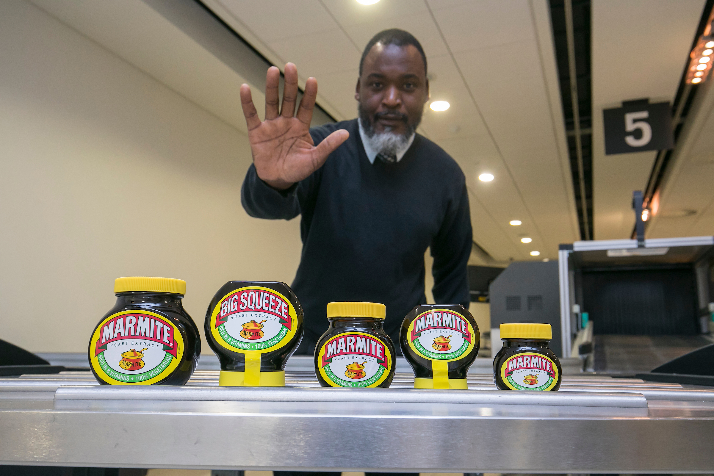 Marmite going through airport security (Marmite/PA)