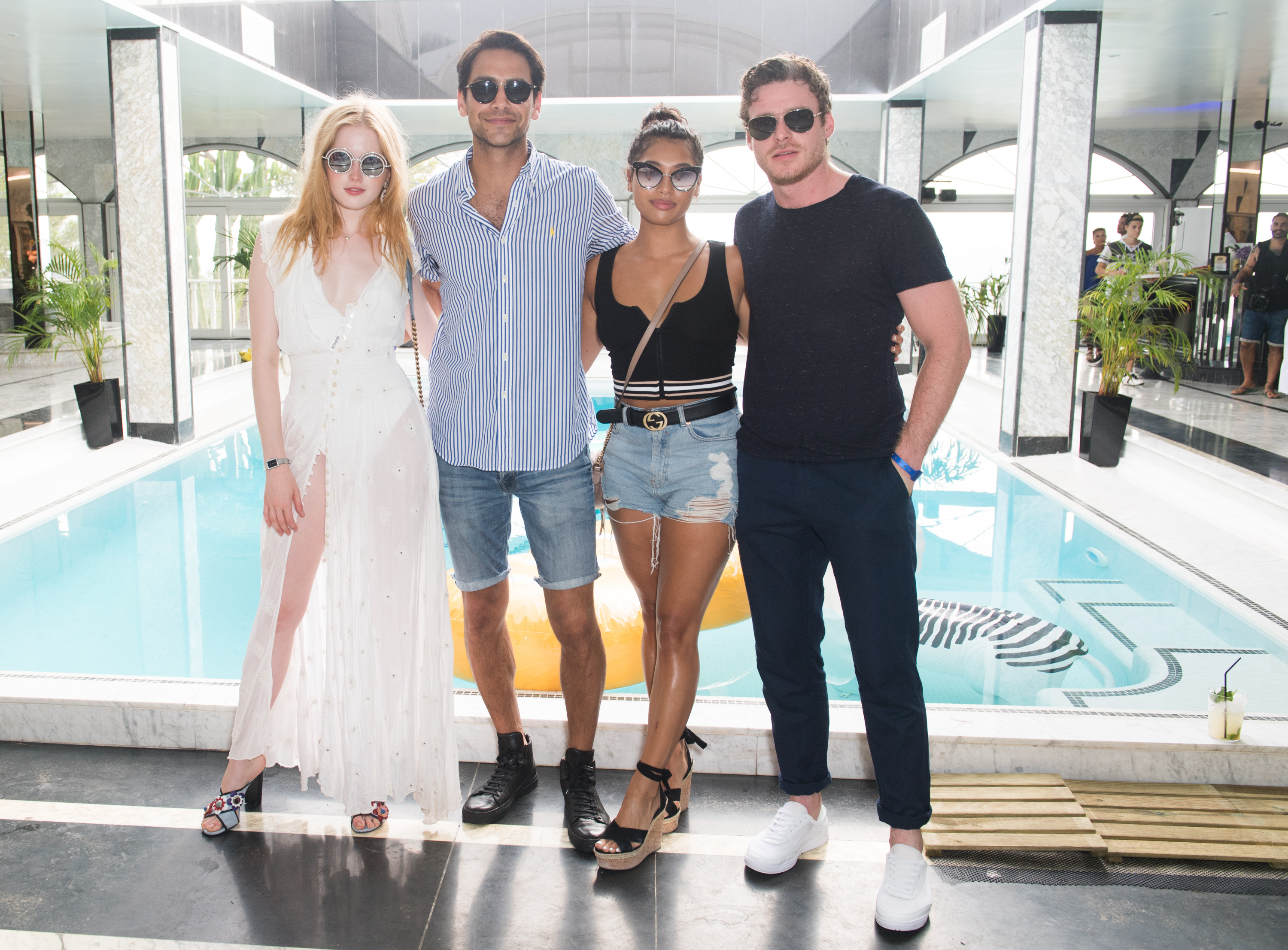 From left: Ellie Bamner, Luke Pasqualino, Vanessa White and Richard Madden attend the Ibiza pool party.