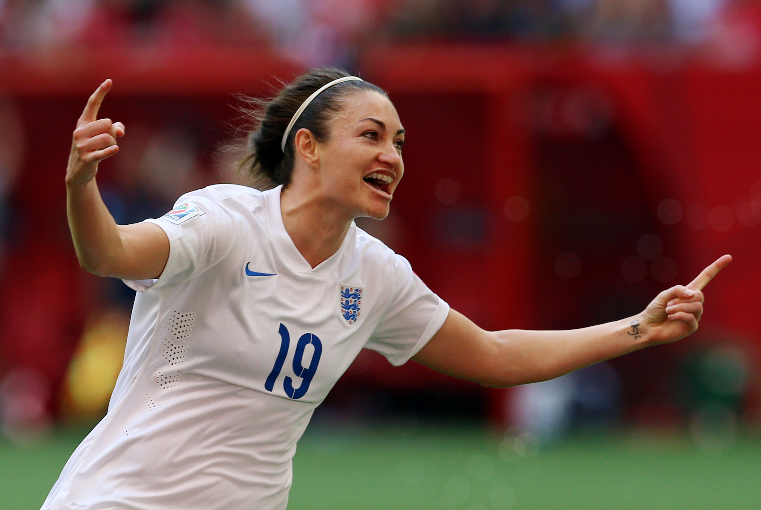 England's Jodie Taylor celebrates scoring at the 2015 World Cup