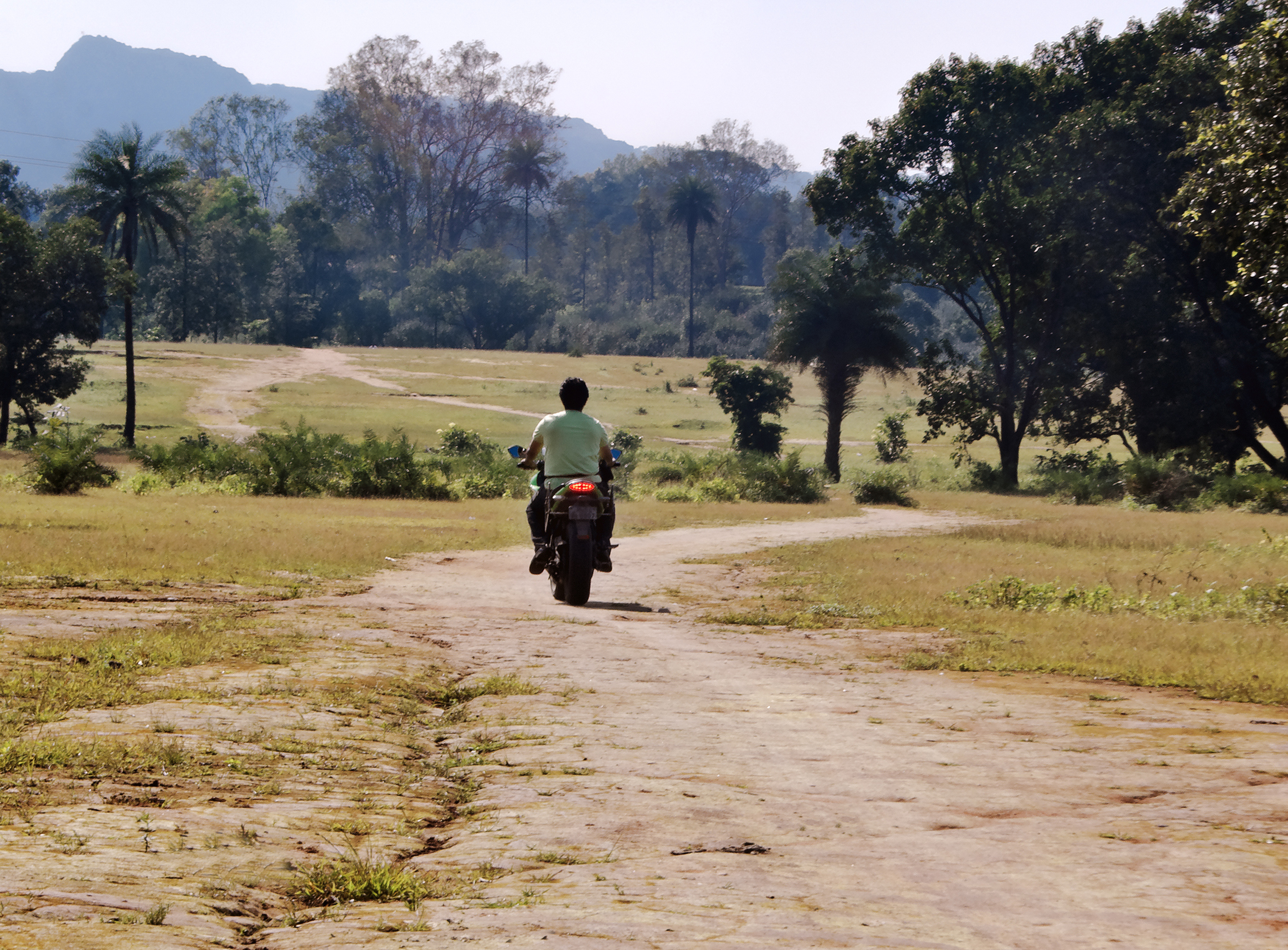 Indian farmer on a moped.