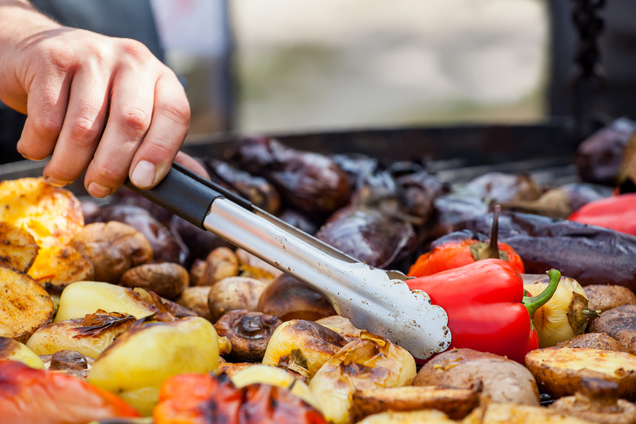 Tongs being used with lots of different vegetables on a grill (Thinkstock/PA)