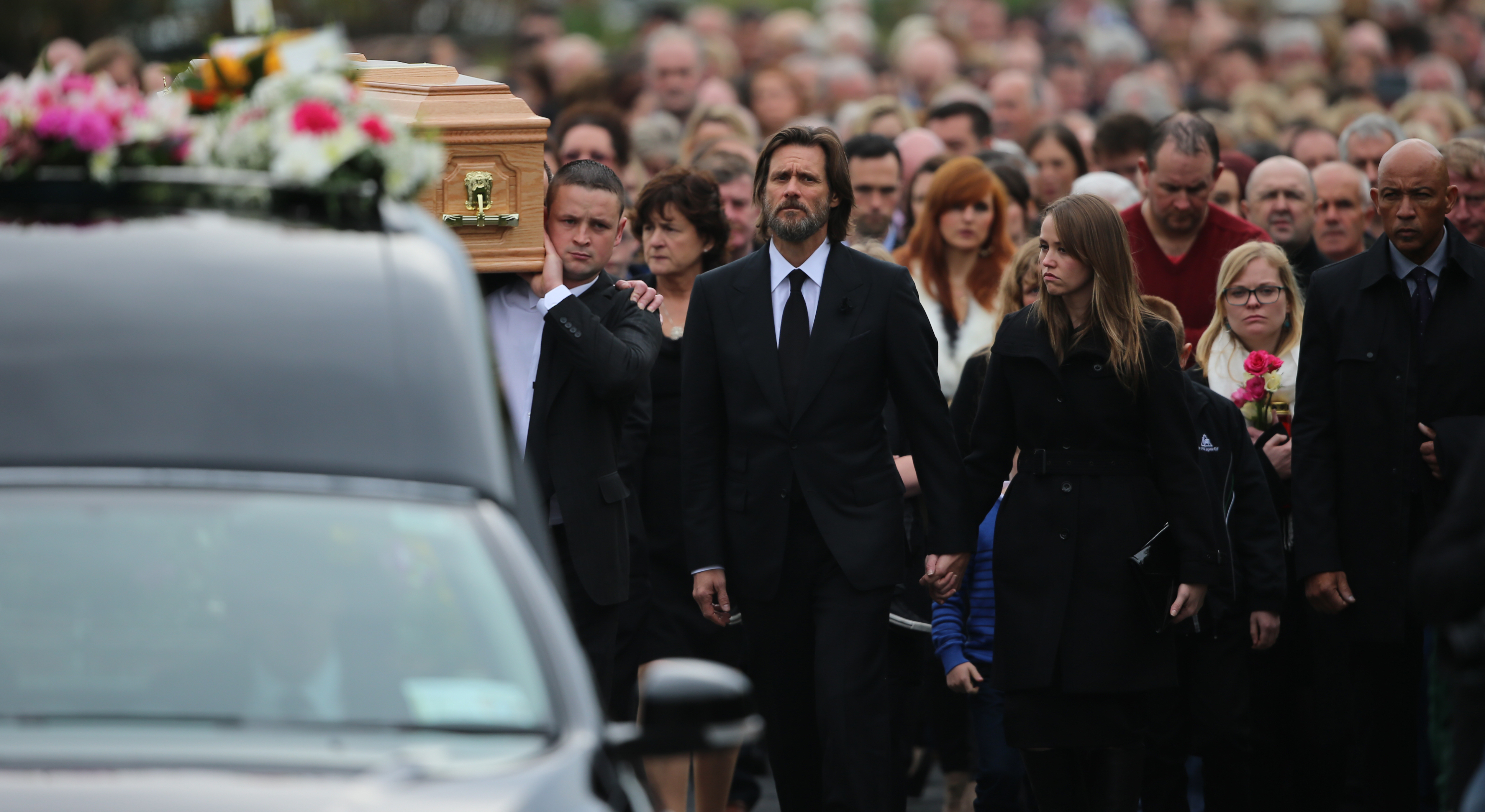 Jim Carrey with mourners