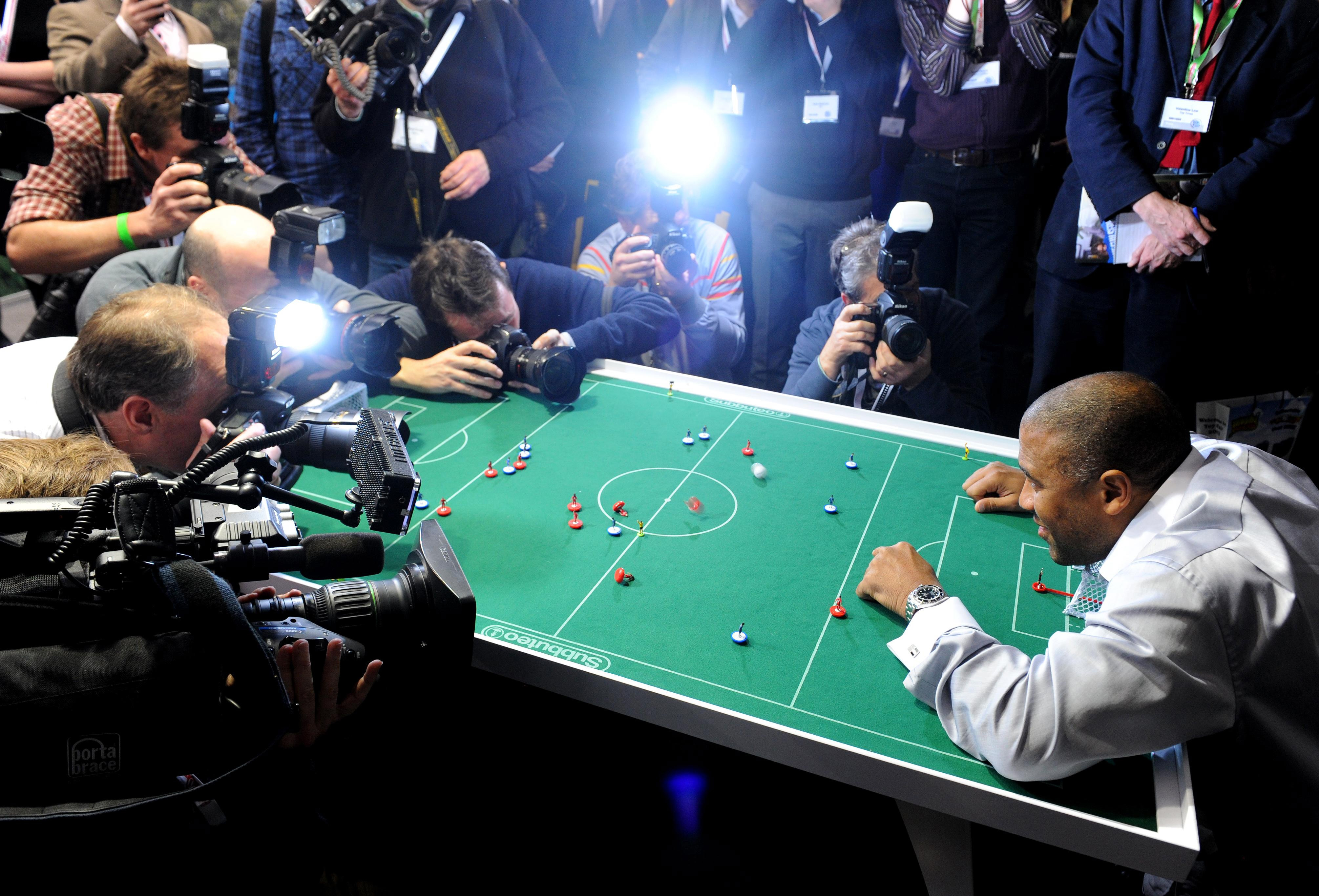 John Barnes playing Subbuteo in front of cameras