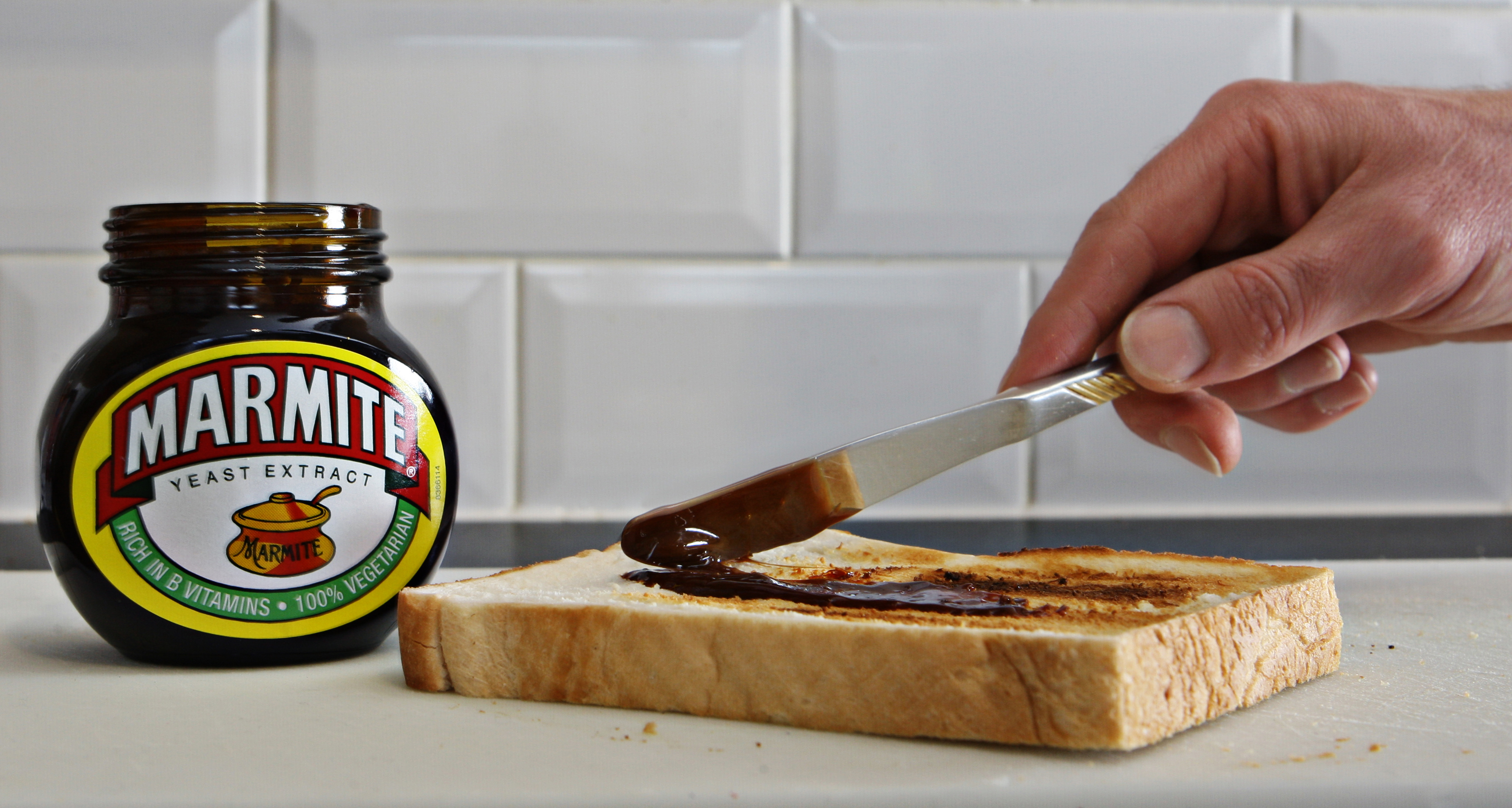 Marmite being spread on bread (Nick Potts/PA)