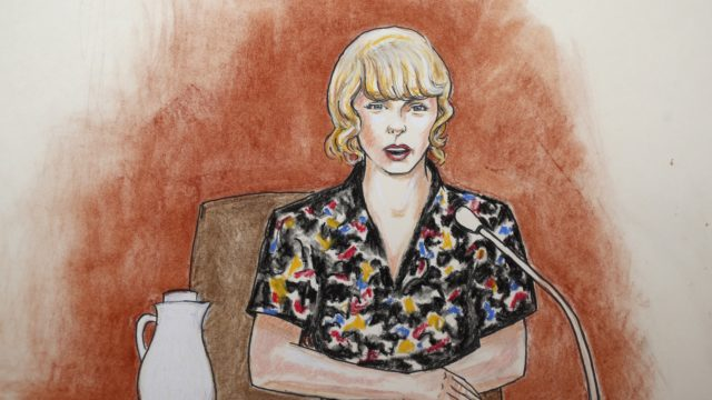 In this courtroom sketch pop singer Taylor Swift speaks from the witness stand during a trial Thursday Aug. 10 2017 in Denver. Swift testified Thursday that David Mueller a former radio DJ reached under her skirt and intentionally grabbed her backsi
