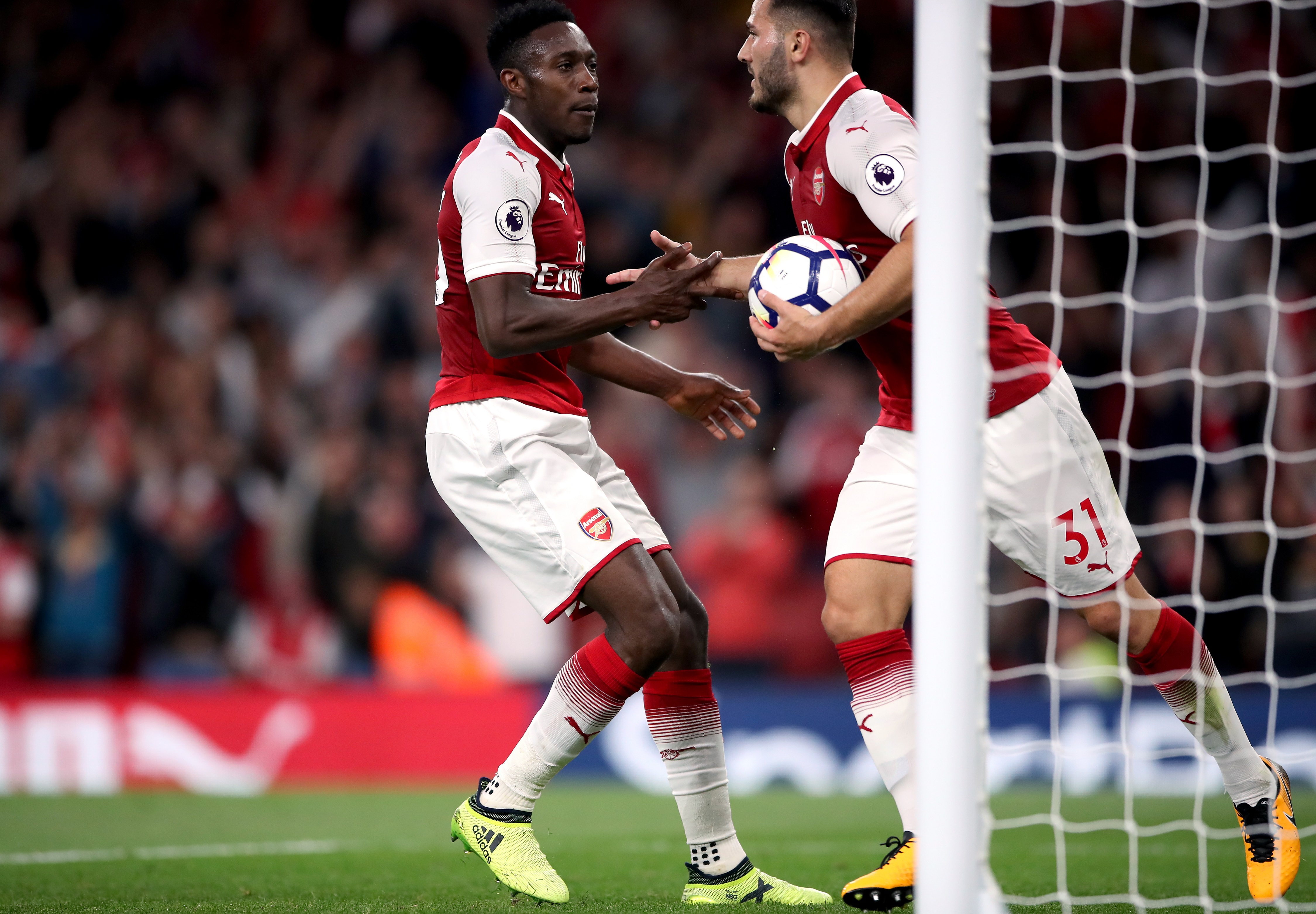 Welbeck celebrates with Kolasinac