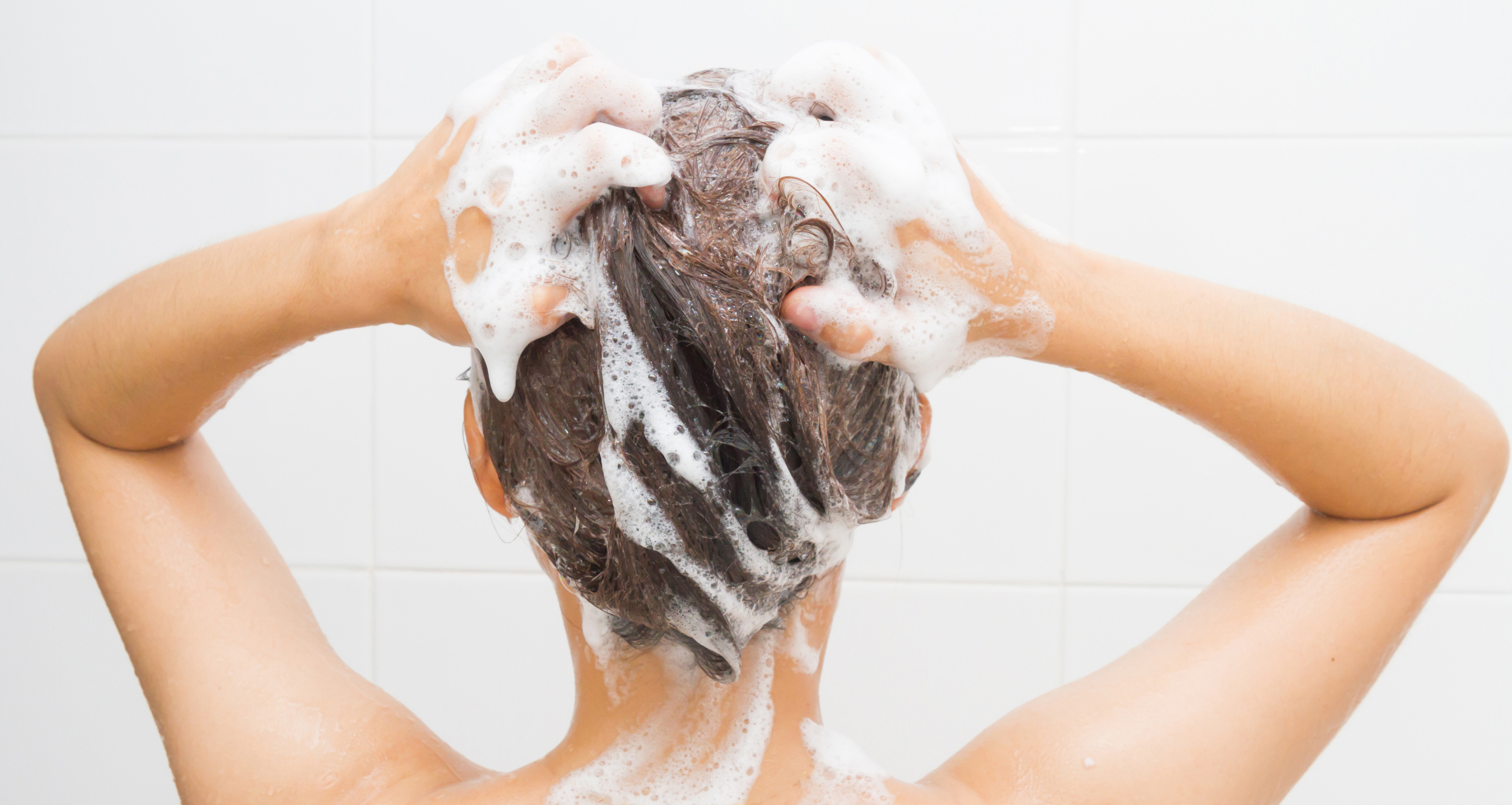 Woman washing her hair (Jringjai/Getty Images)