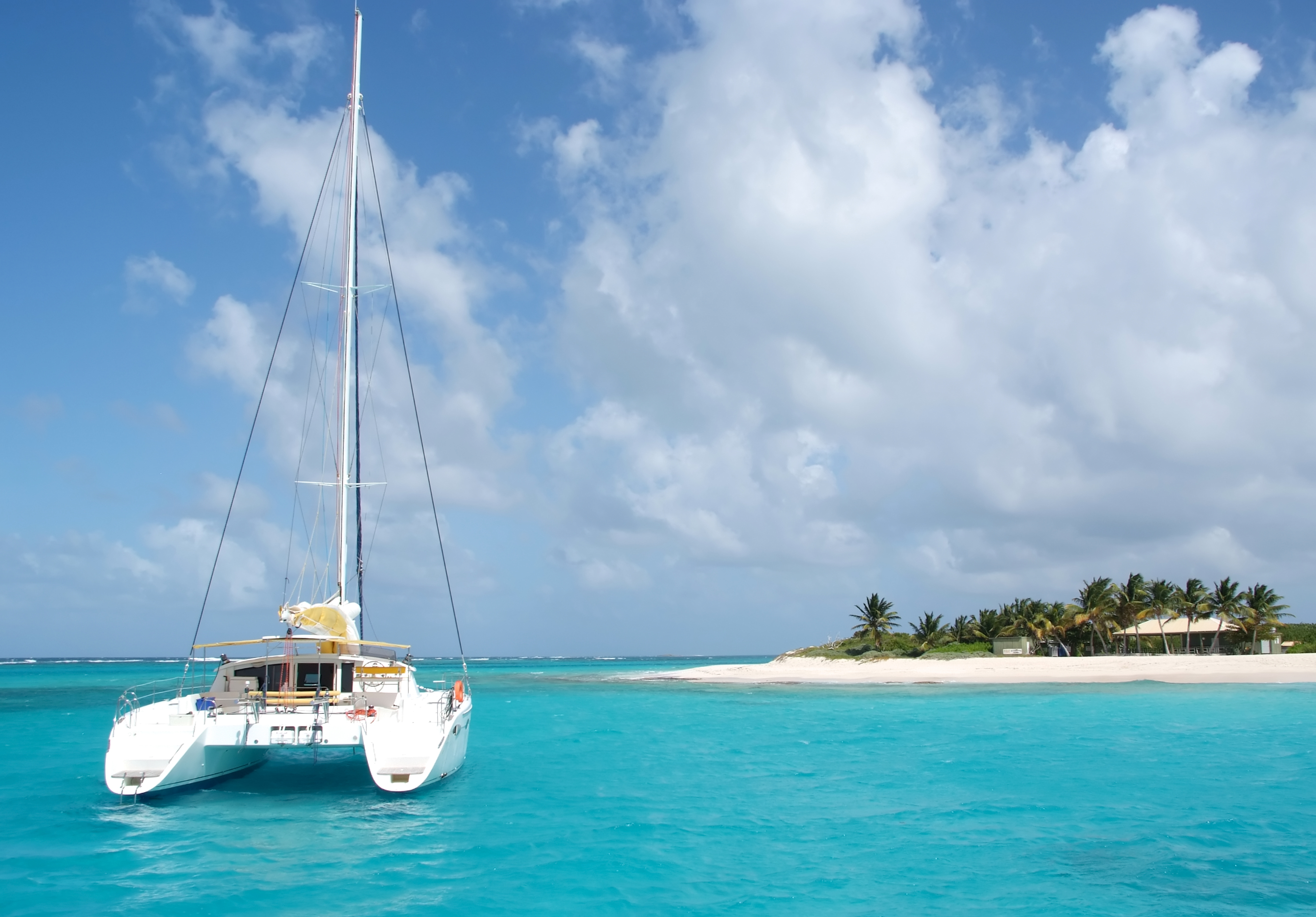 A catamaran near a beach (Marcel Krol/Getty Images)
