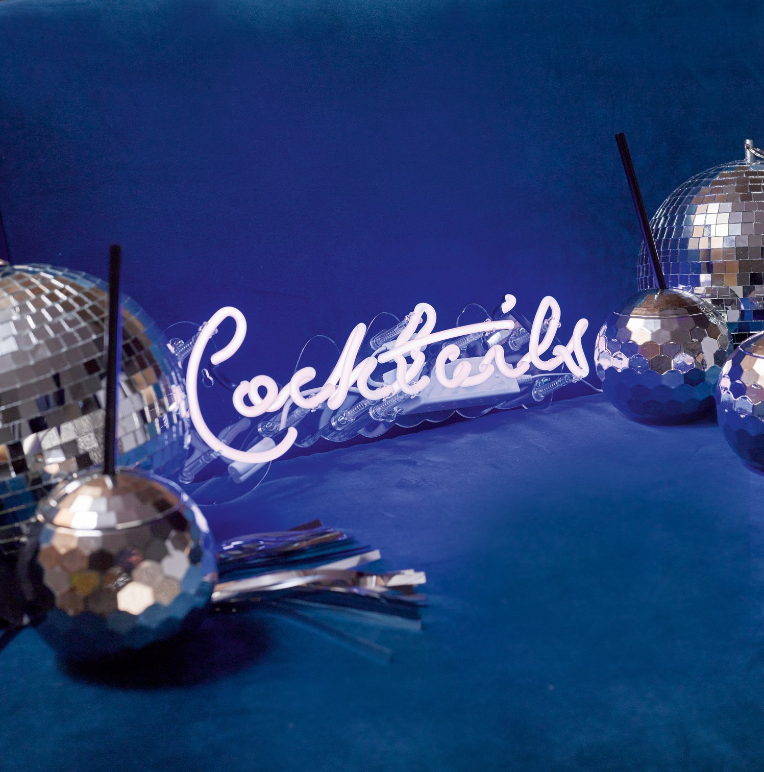 Cocktails neon light, £69.99, Glitterati disco ball, £13.99; and disco ball shaped cups £9.99 for a pack of two, Talking Tables (Talking Tables/PA)