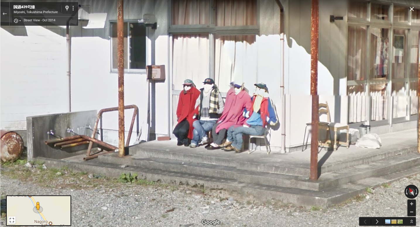 Dolls on a bench in the Japanese town
