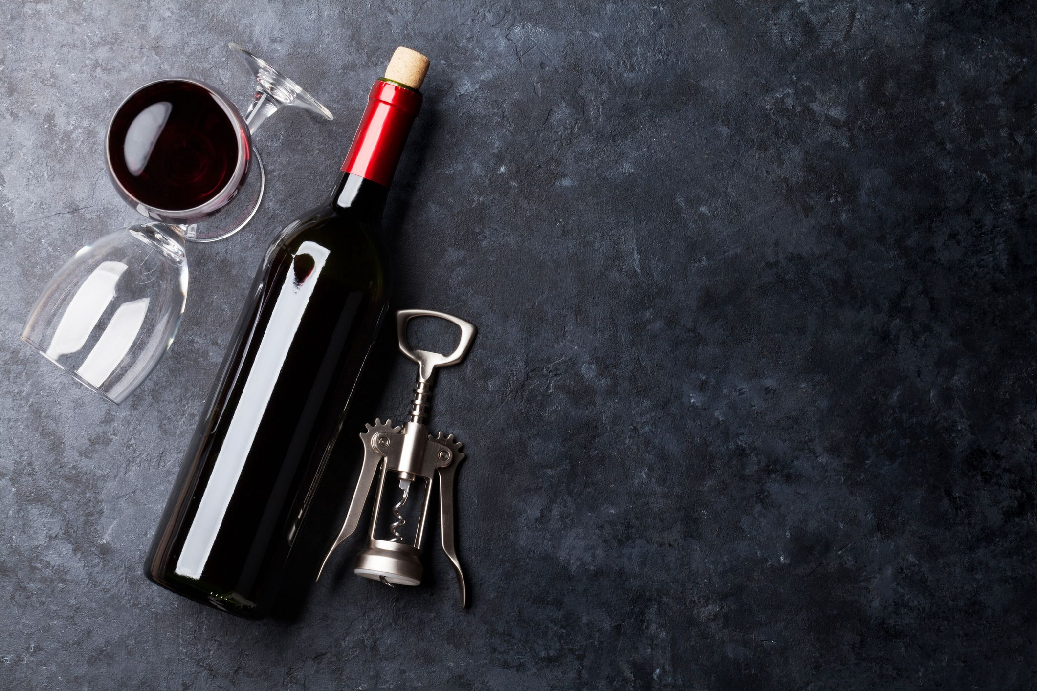 Red wine glasses and bottle on table