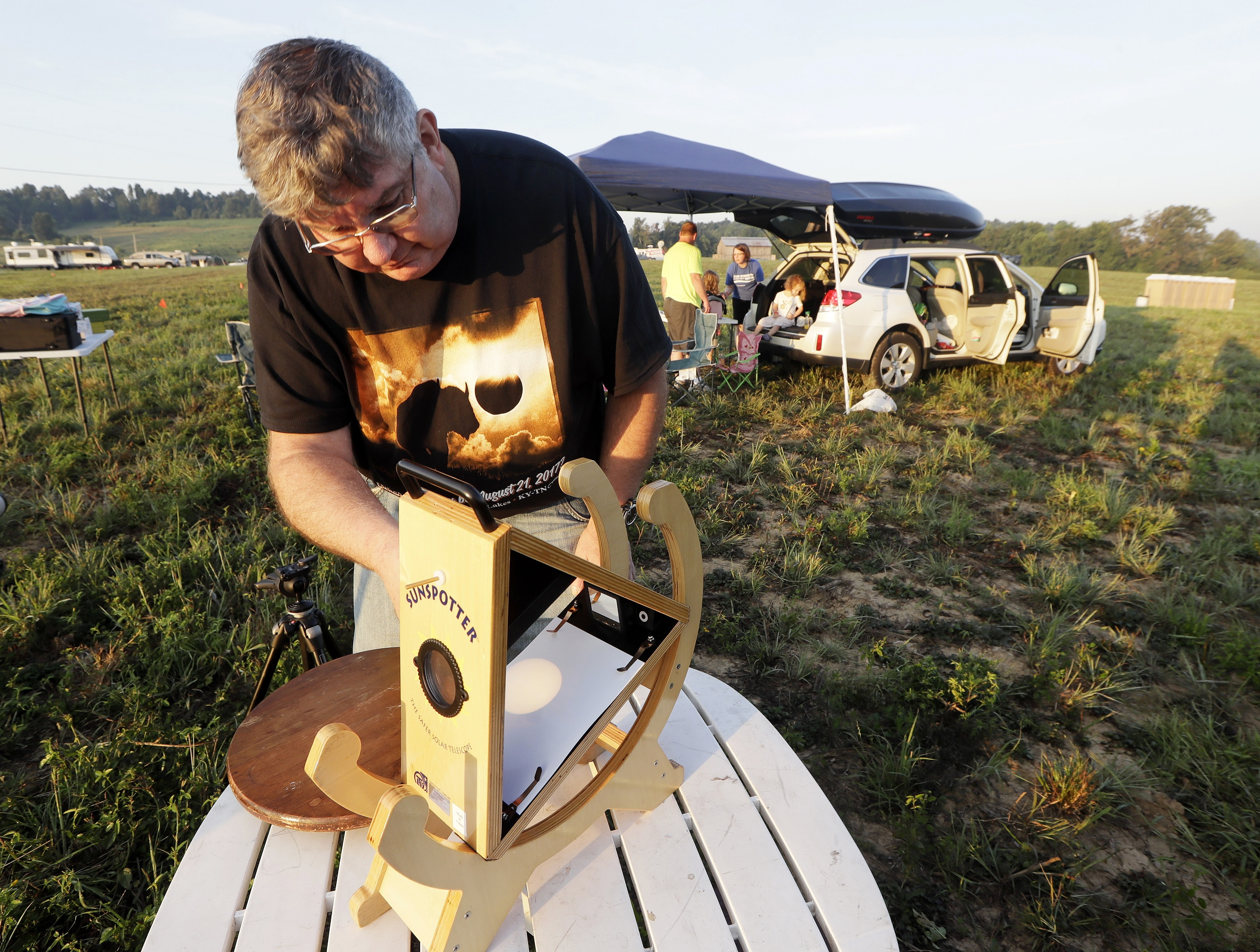 Someone sets up a Sunspotter, a device for viewing the solar eclipse