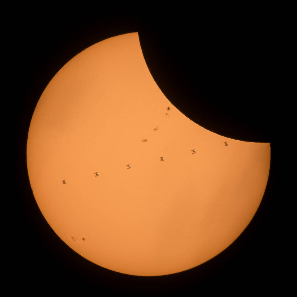 The International Space Station seen as well as the partial eclipse in the US in 2017 (Joel Kowsky/AP)