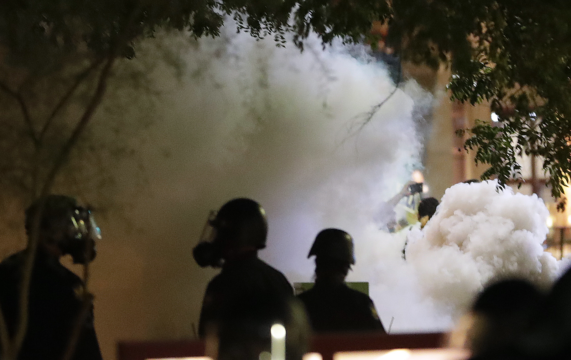 Smoke billows after Phoenix police used tear gas outside the Phoenix Convention Center
