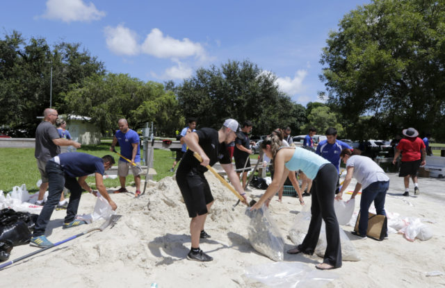 Volunteers in Miami fill sandbags ahead of Irma