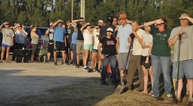Florida residents await the arrival of sandbags