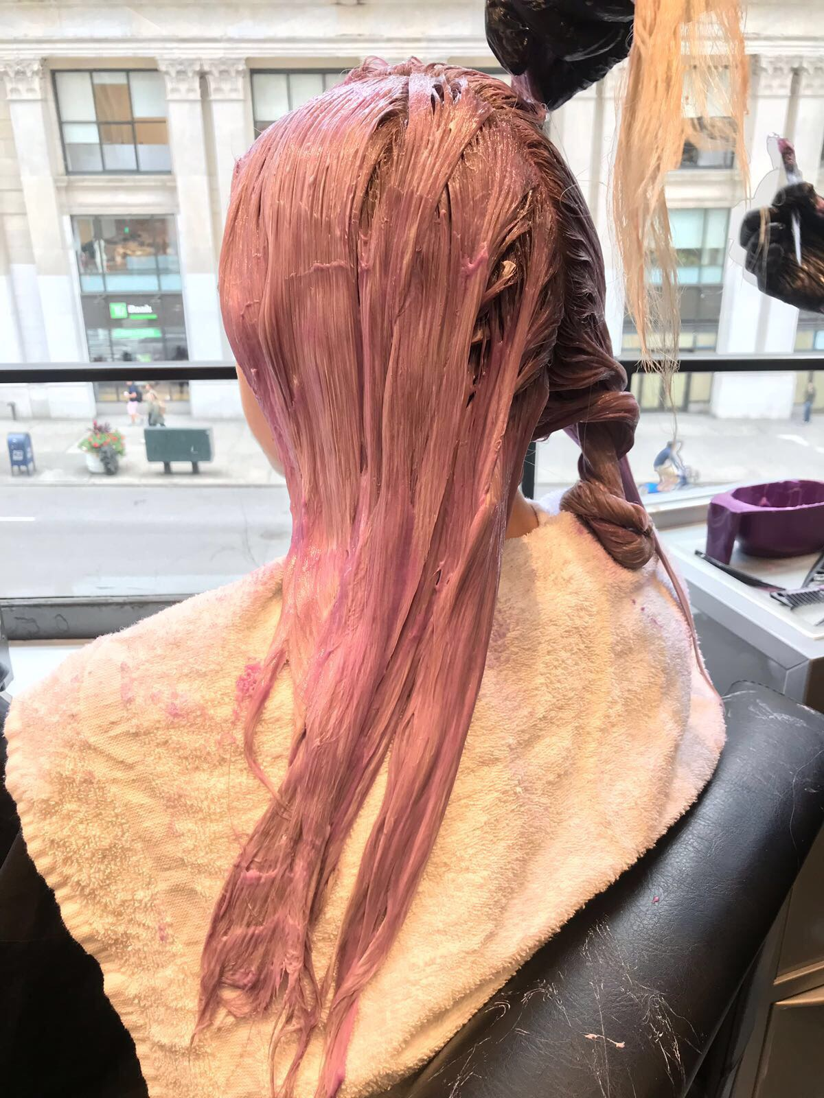 model having pink hair dye applied