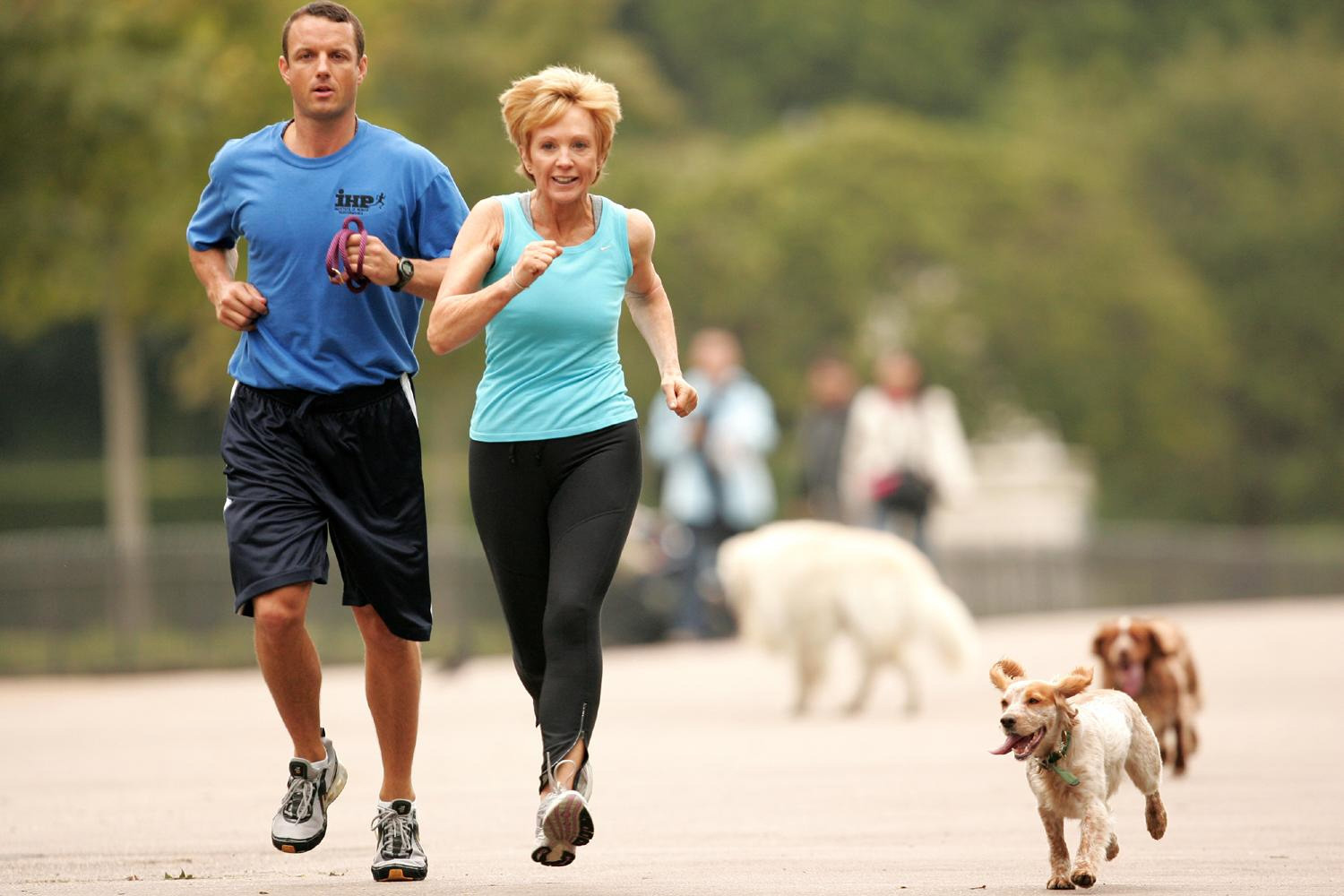 Anne Robinson, jogging with her personal trainer and dog (2007) (Terry Richards/PA)