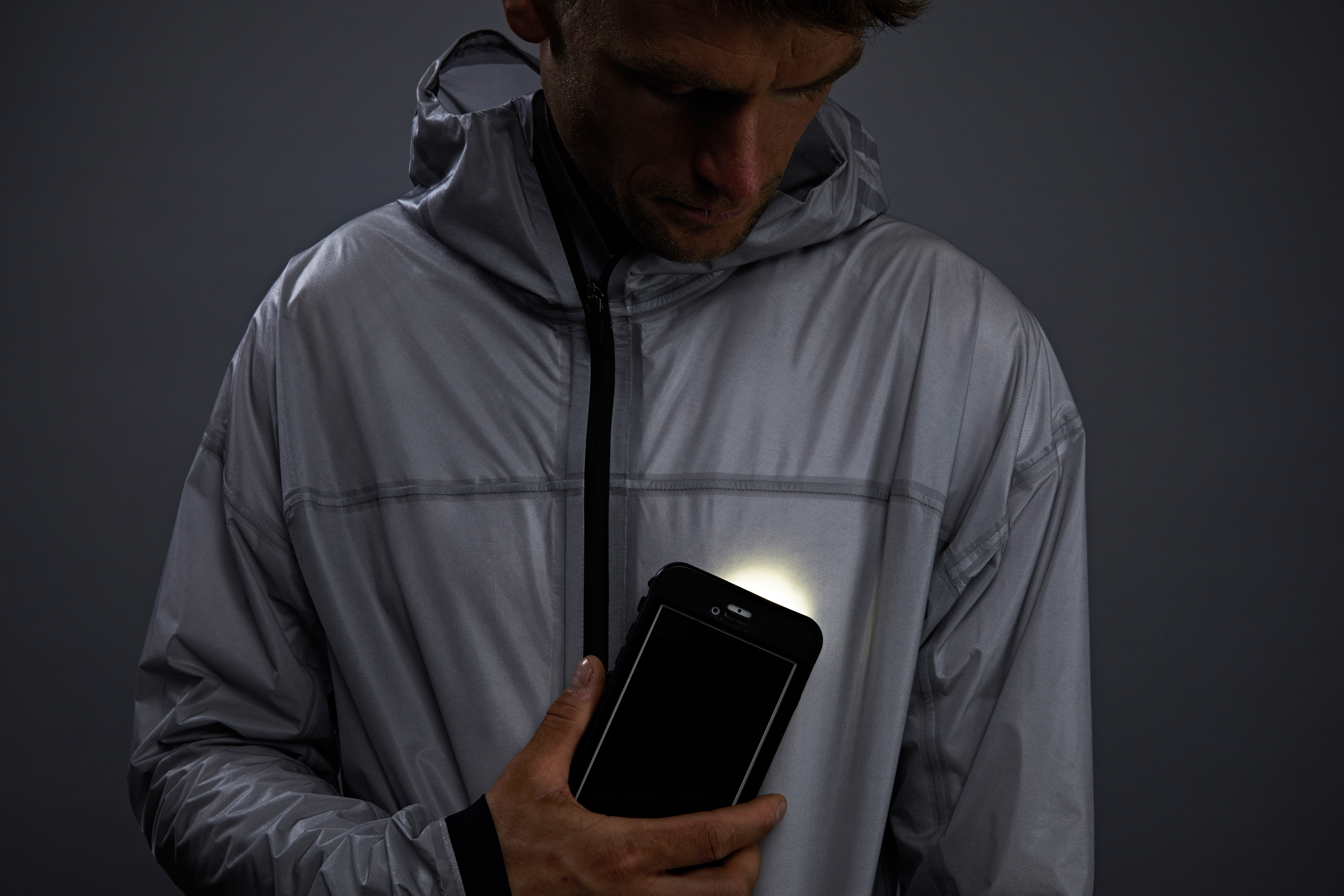 A smartphone is used to power The Solar Charged Jacket from Vollebak (Sun Lee/Vollebak)