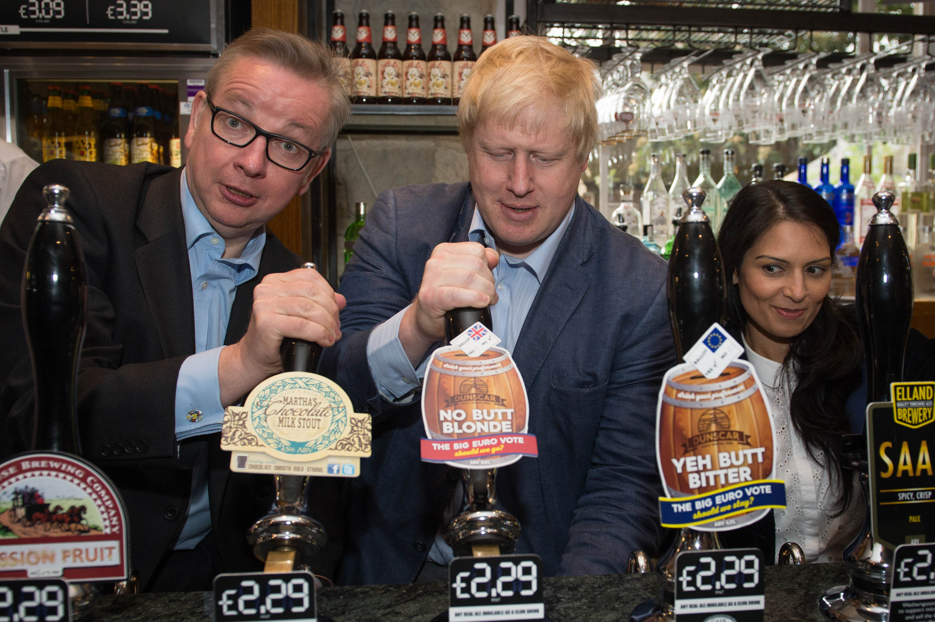 Michael Gove, Boris Johnson (centre) and Priti Patel pull pints of beer