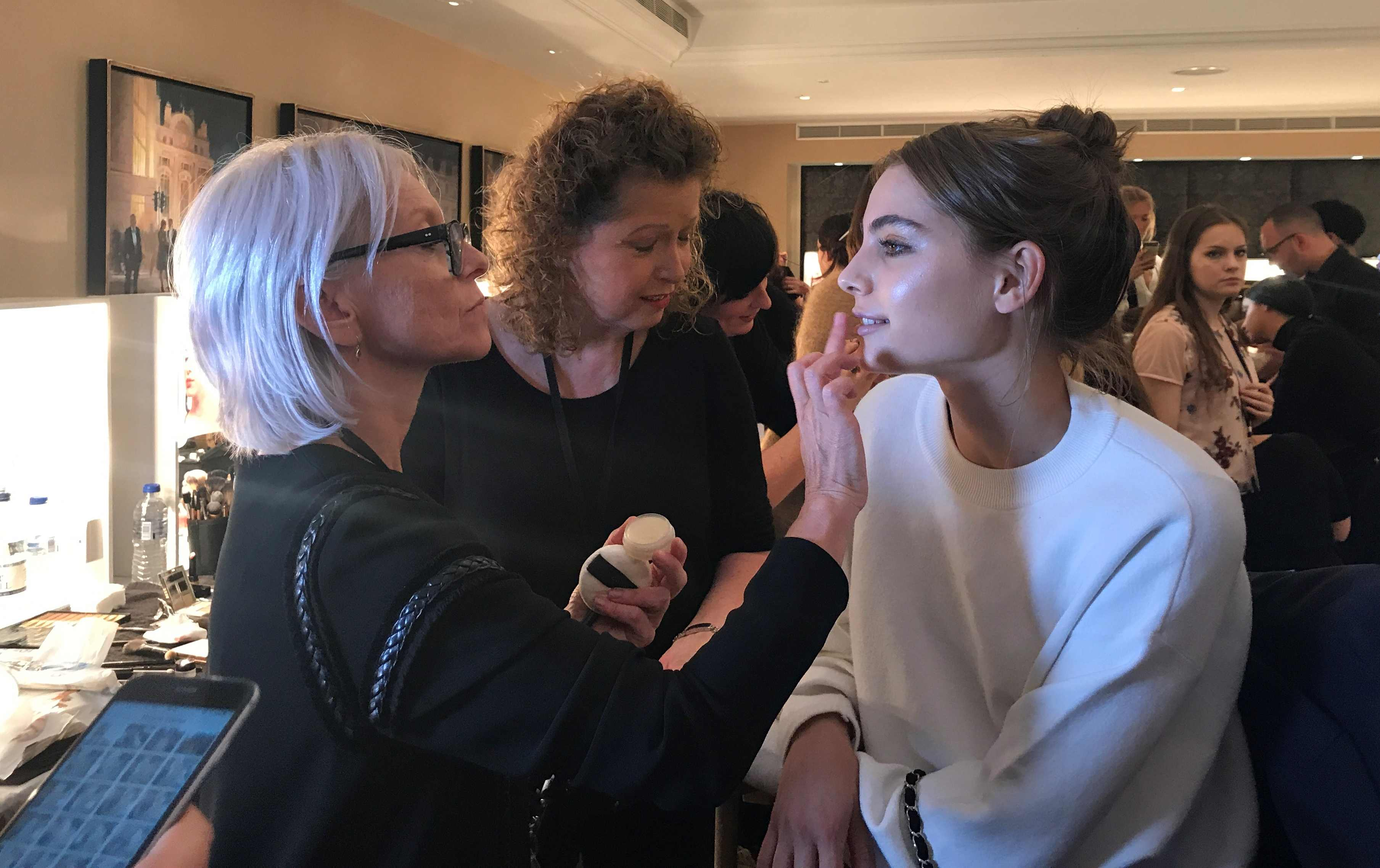 make-up artist Maria Comparetto at work backstage at Daks SS18 at london fashion week