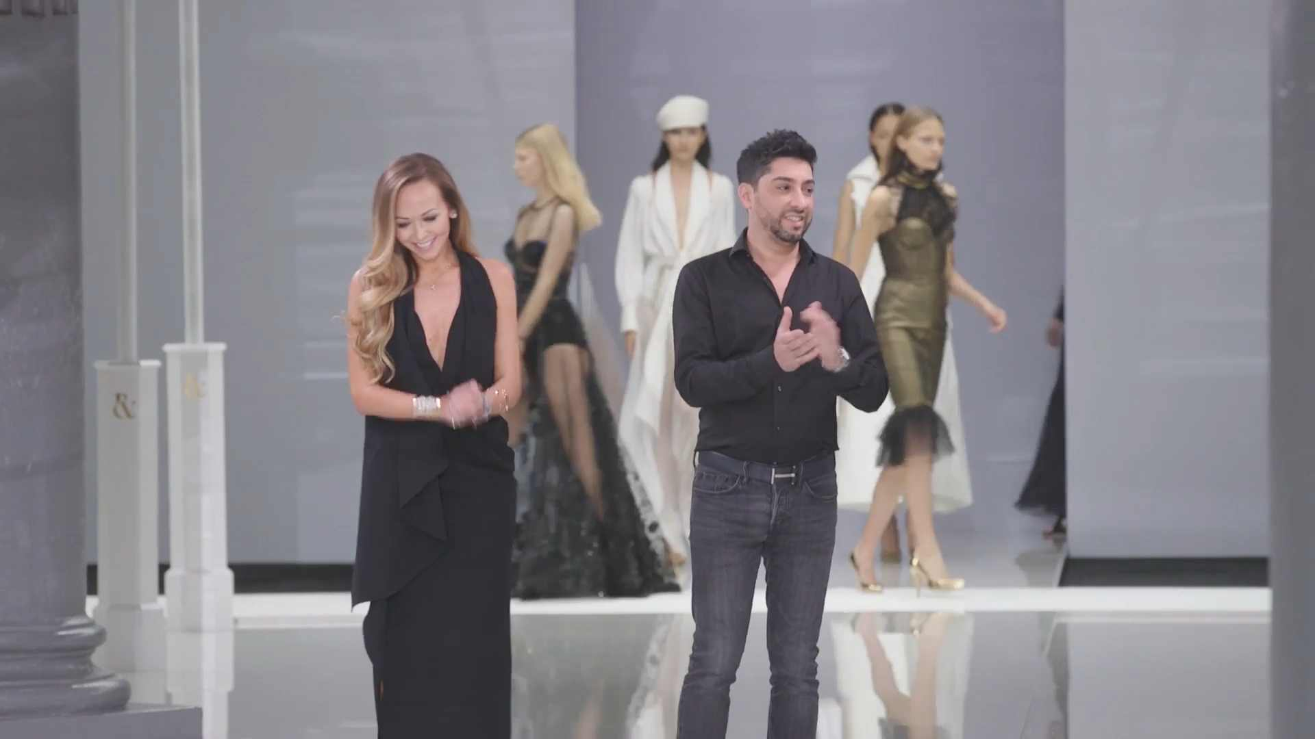 Tamara Ralph and Michael Russo take their bow on the catwalk at London Fashion Week