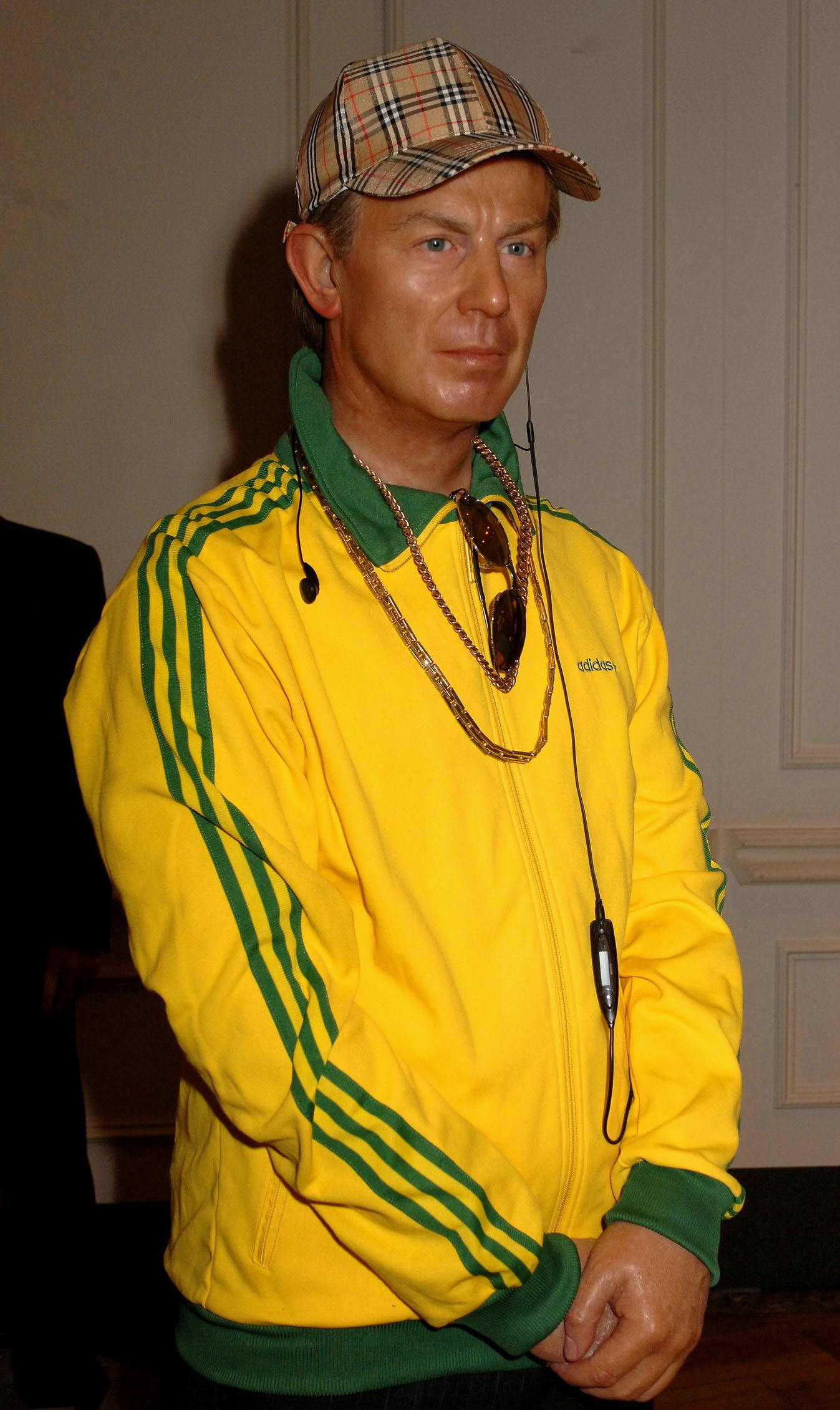 Tony Blair's wax work figure at Madame Tussauds wearing a tracksuit and Burberry baseball cap