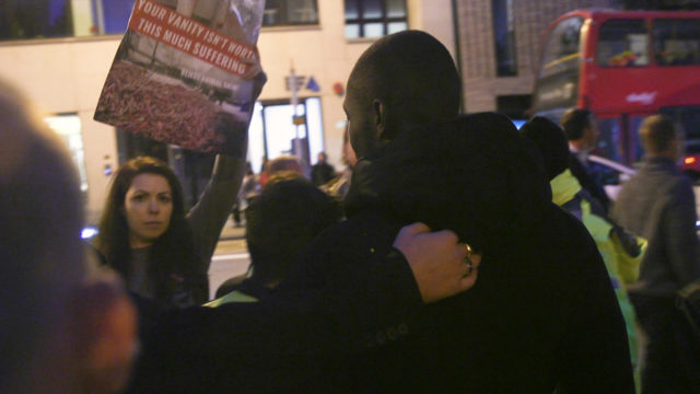 Stormzy is confronted with a placard outside the Burberry show at London Fashion Week