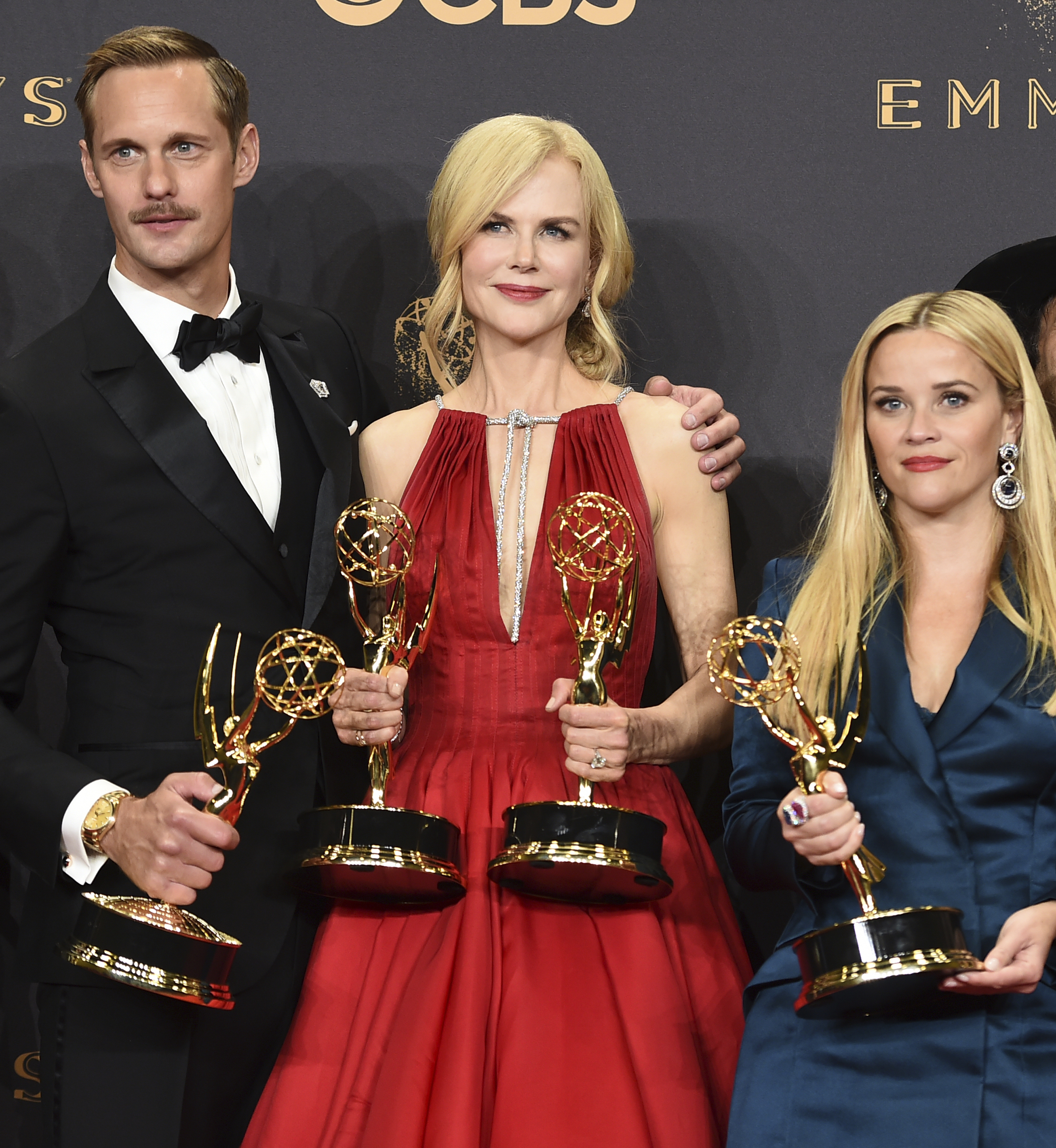 Alexander Skarsgard, Nicole Kidman, and Resse Witherspoon pose with their awards (Jordan Strauss/Invision/AP)