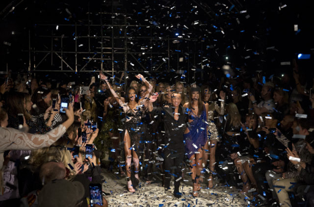 Julien Macdonald and models celebrate the end of hie London Fashion Week show SS18