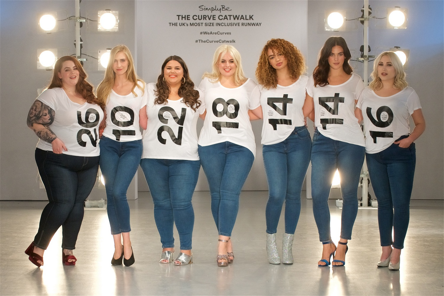 Models from sizes 10 to 26 pose on the Curve Catwalk
