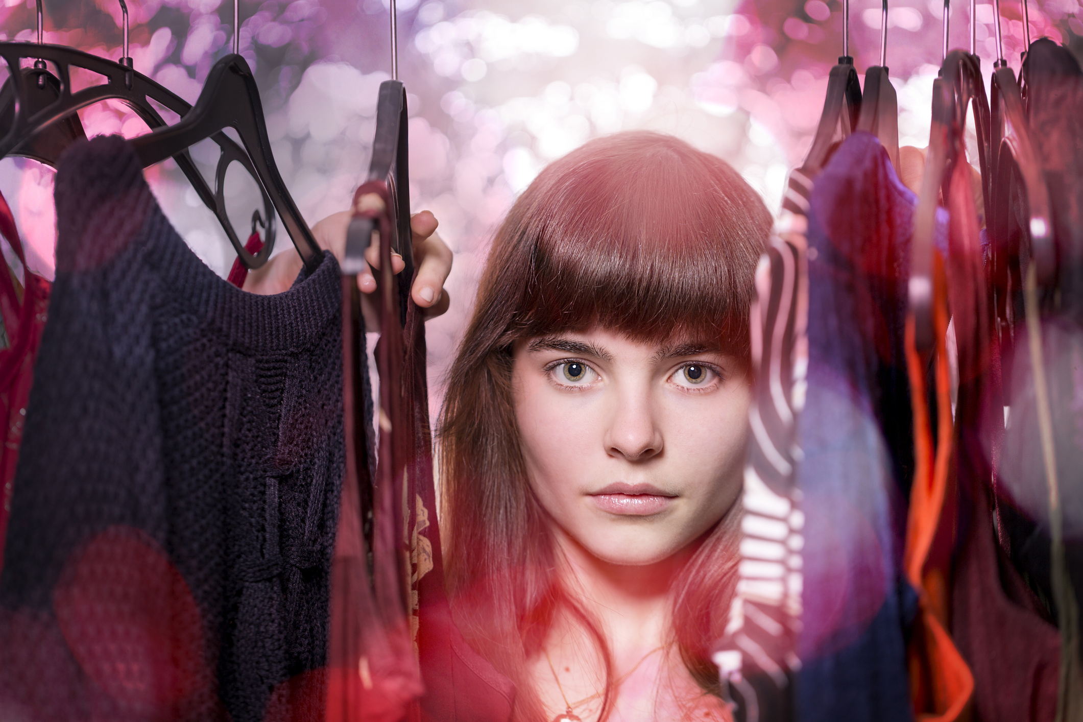 A girl looks through her wardrobe of clothes (Thinkstock/PA)