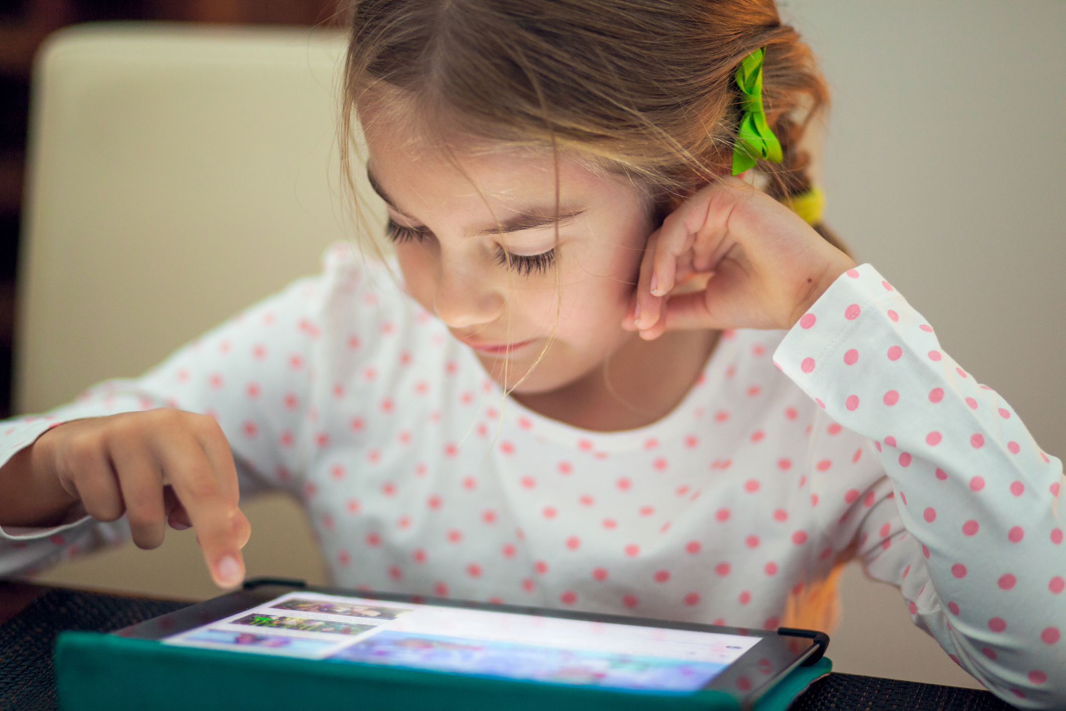 Little girl playing on her tablet at home (Thinkstock/PA)