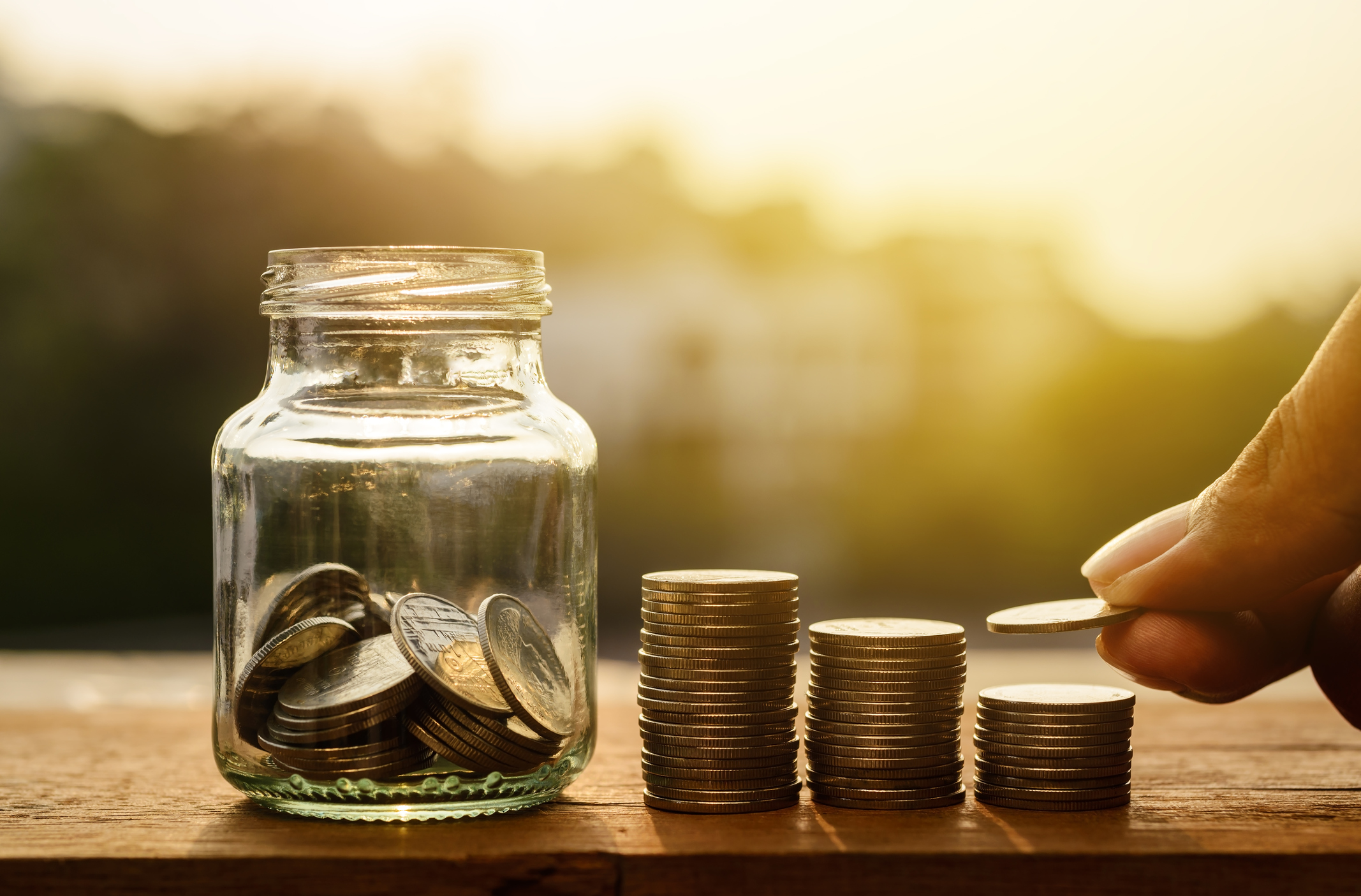 A savings jar with piles of coins (Thinkstock/PA)