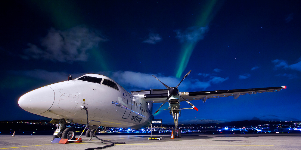 Plane with aurora in background