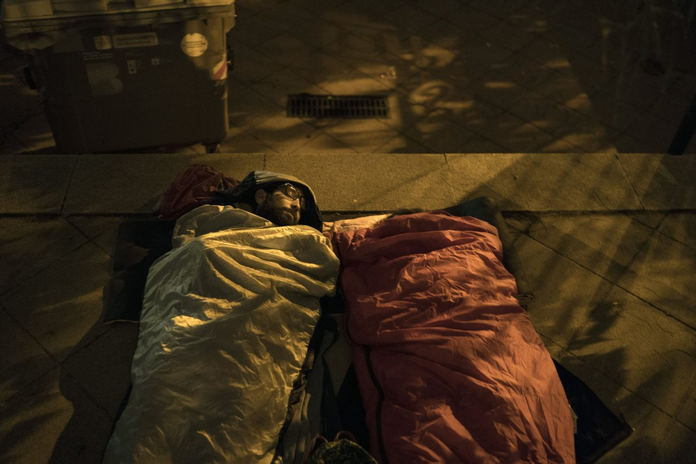 Pro-referendum supporters sleep at a school listed to be a polling station by the Catalan government (Felipe Dana/AP)