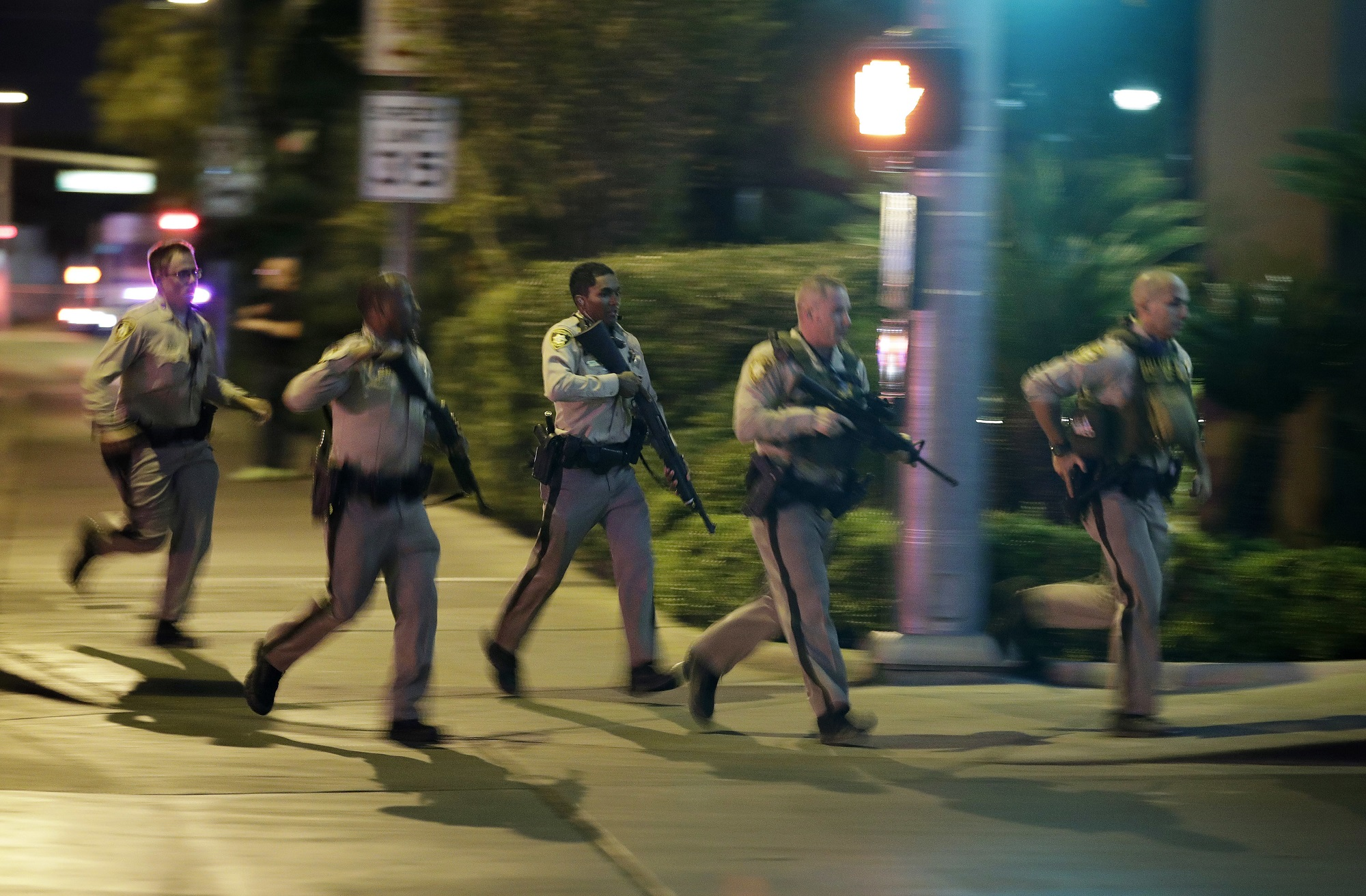 Blurred image of heavily armed police officers running