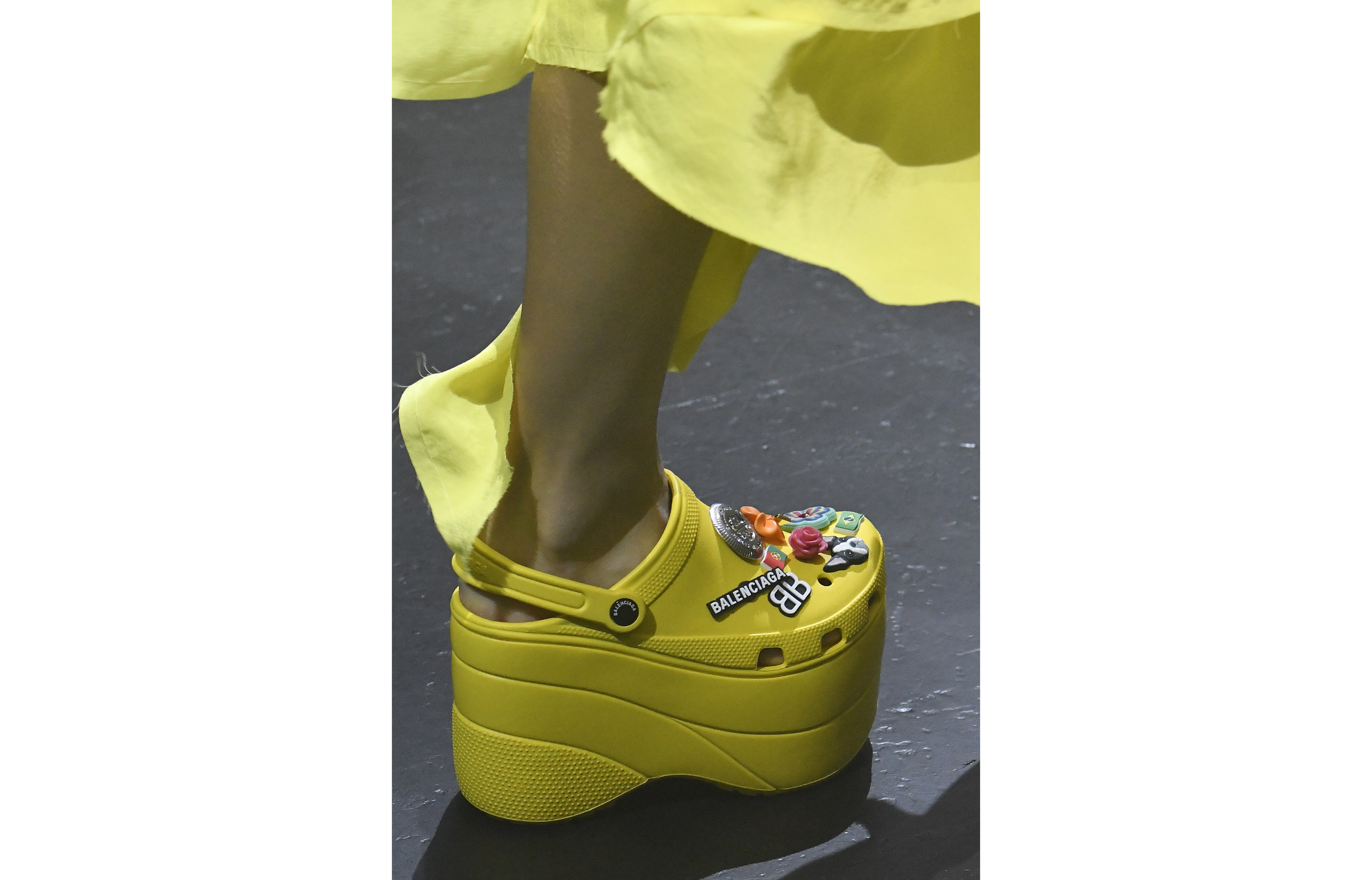 close up of model wearing yellow Balenciaga Crocs on the SS18 catwalk