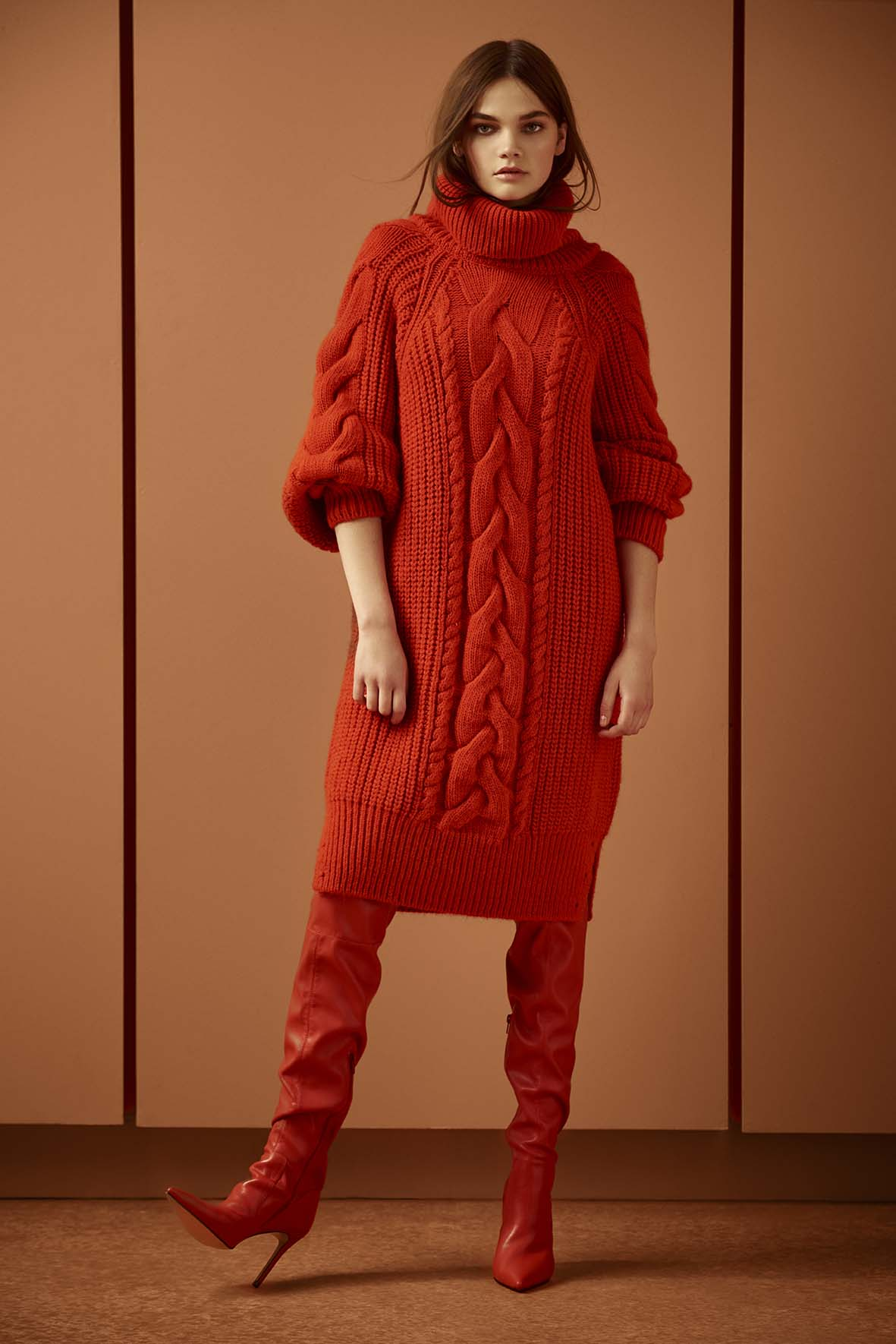model wearing River Island Red Cable Knit Midi Jumper Dress, £55; Red Over the Knee Heeled Boots, £85